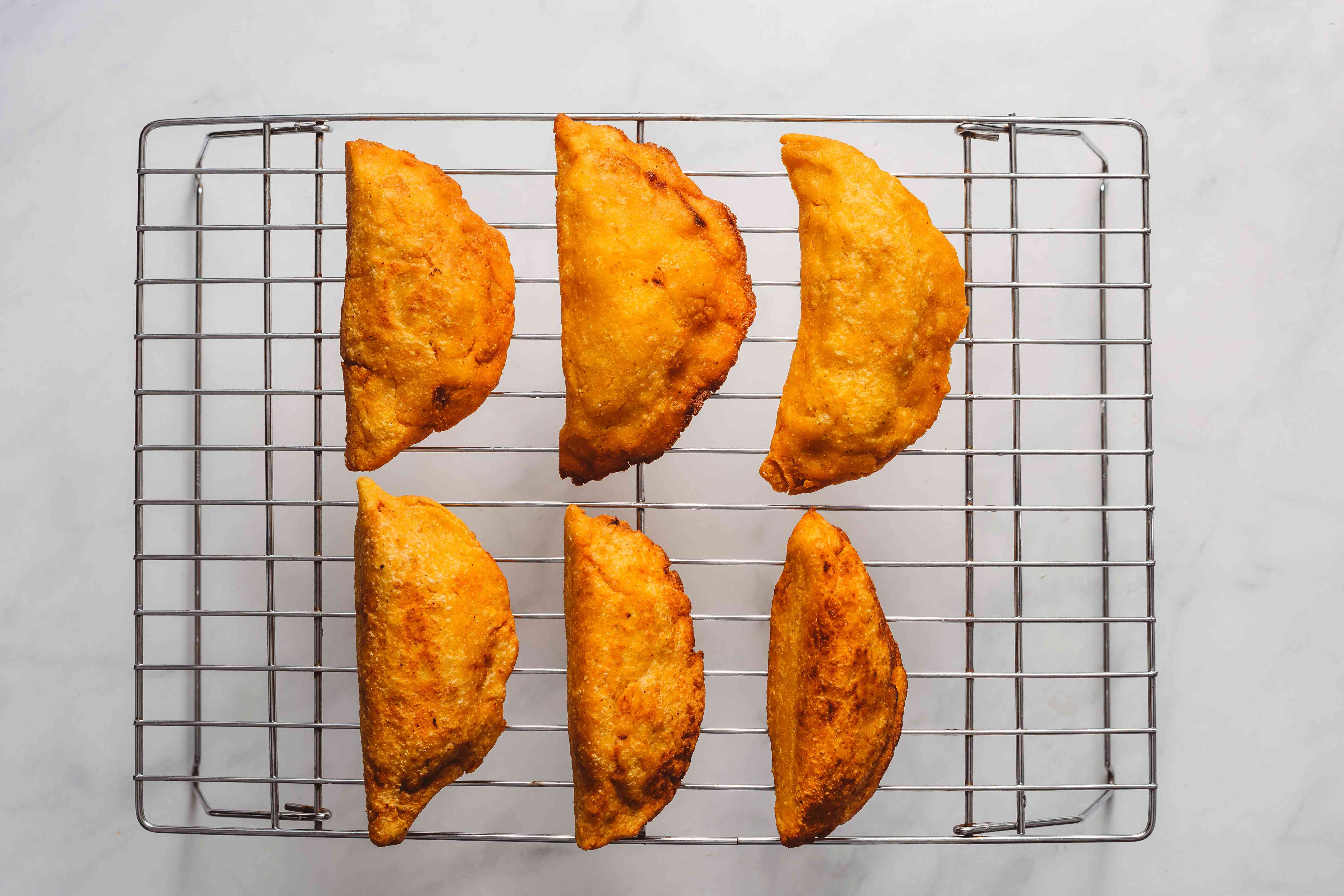 Traditional Fried Mexican Quesadillas on a cooling rack