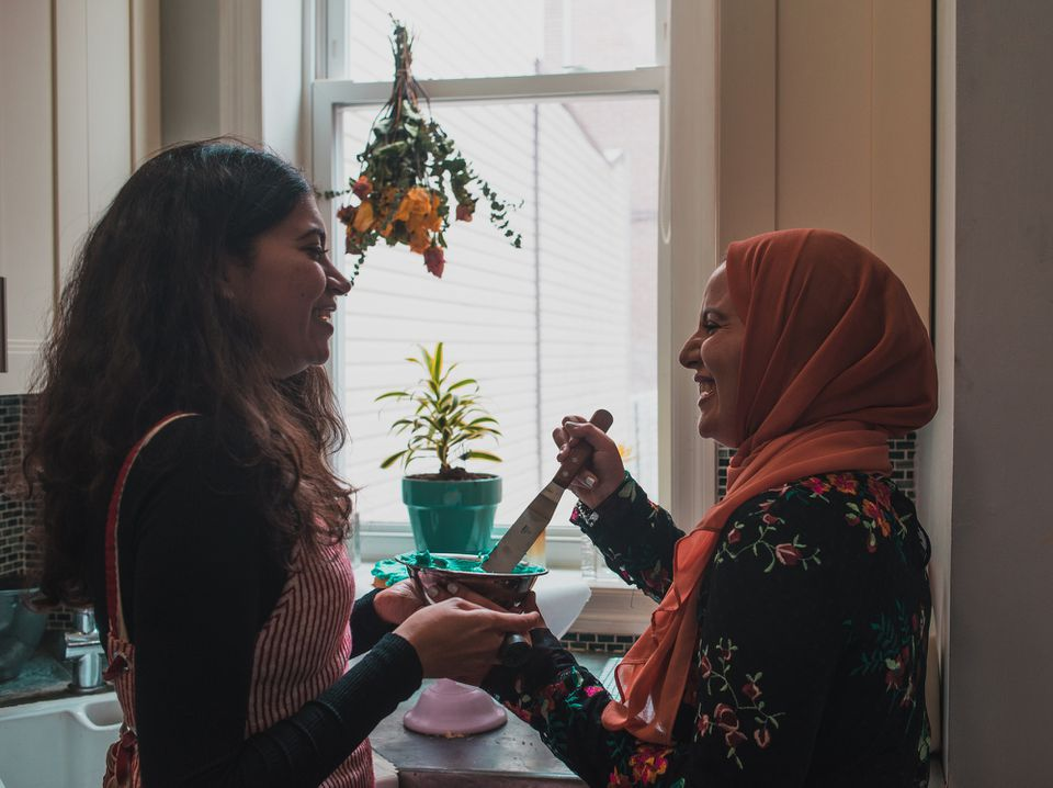 Two arab woman preparing for a birthday party
