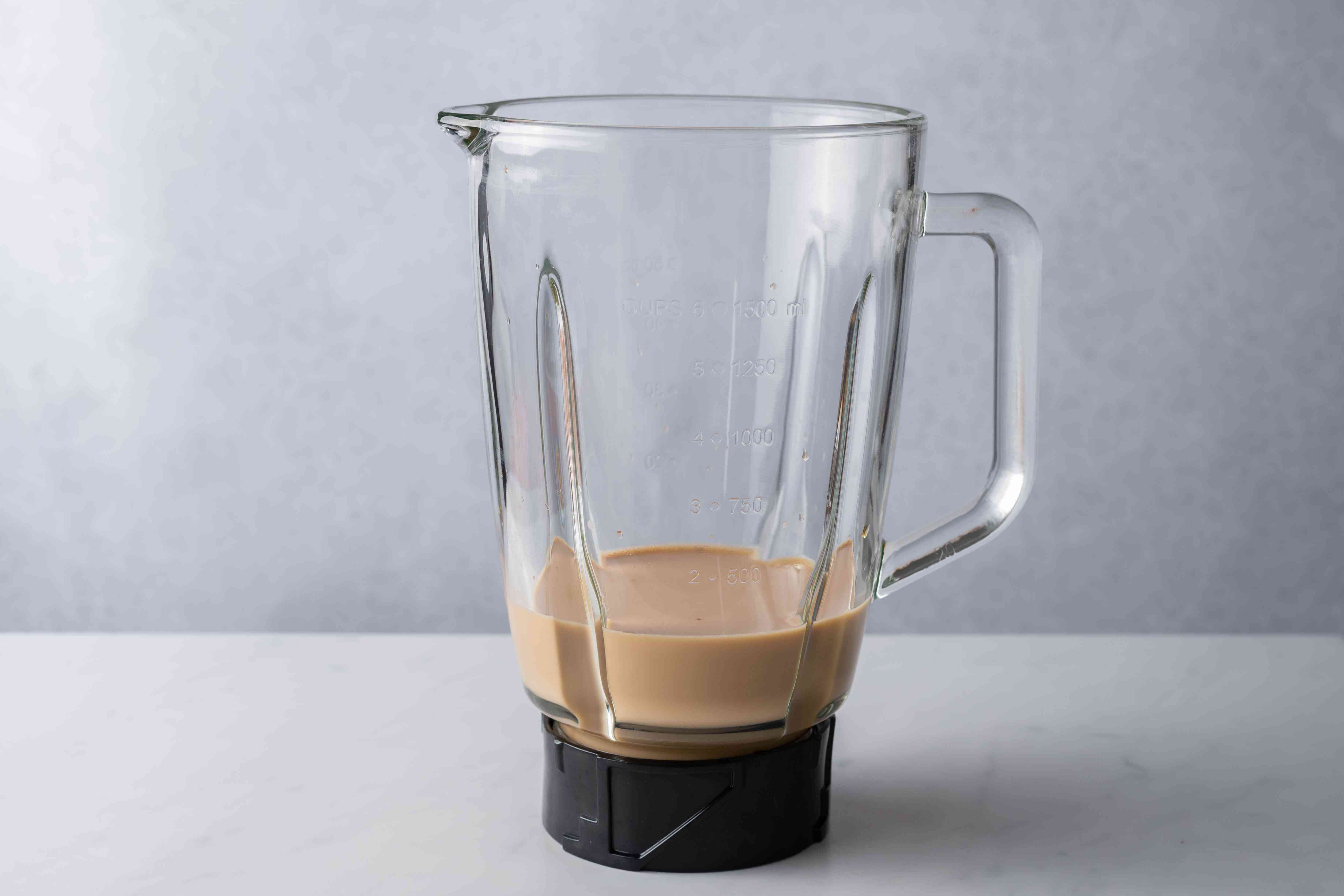 whole milk, strong coffee, and chocolate syrup in a blender