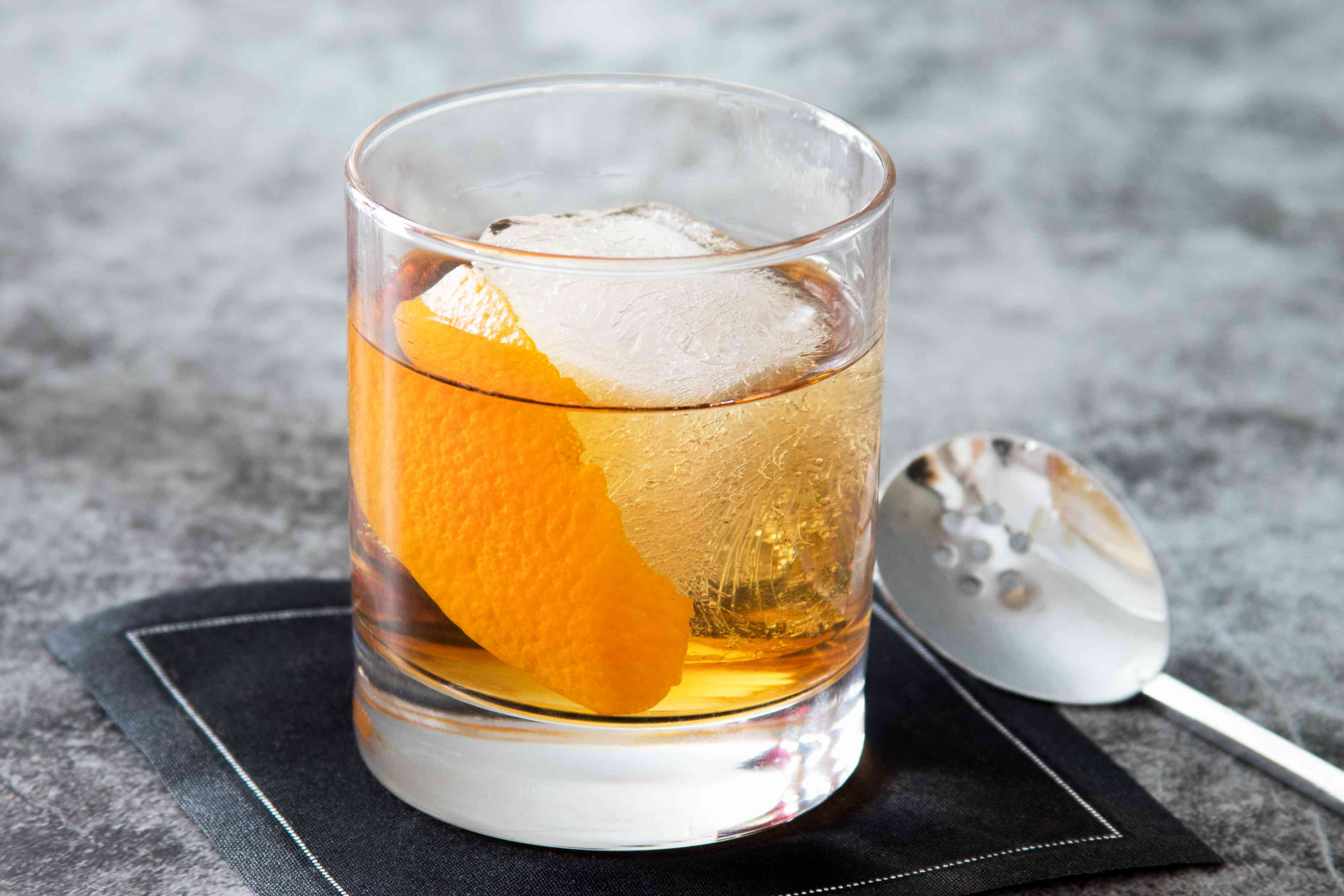 Rum Old-Fashioned Cocktail with orange peel