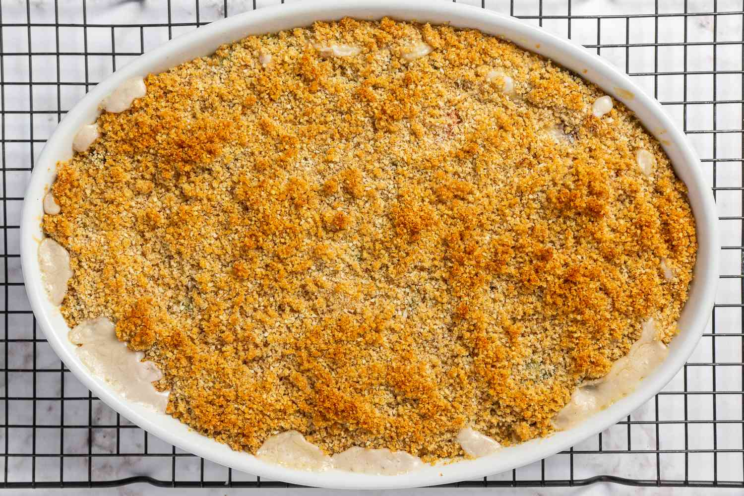 Scalloped Vegetable Casserole on a cooling rack