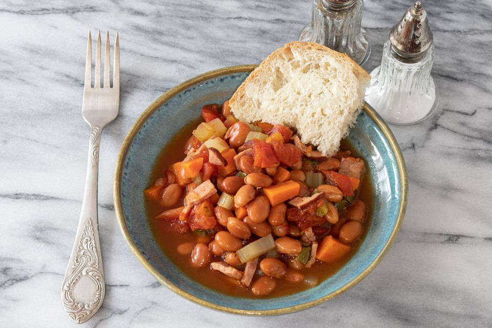 Easy pinto beans in a bowl with slice of bread.