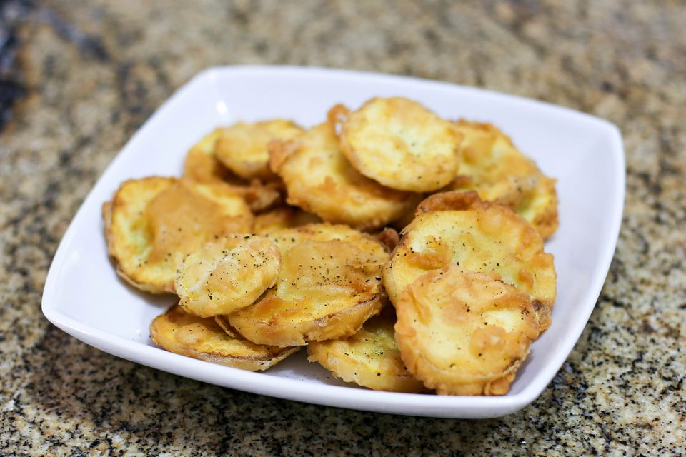 fried summer squash on a plate
