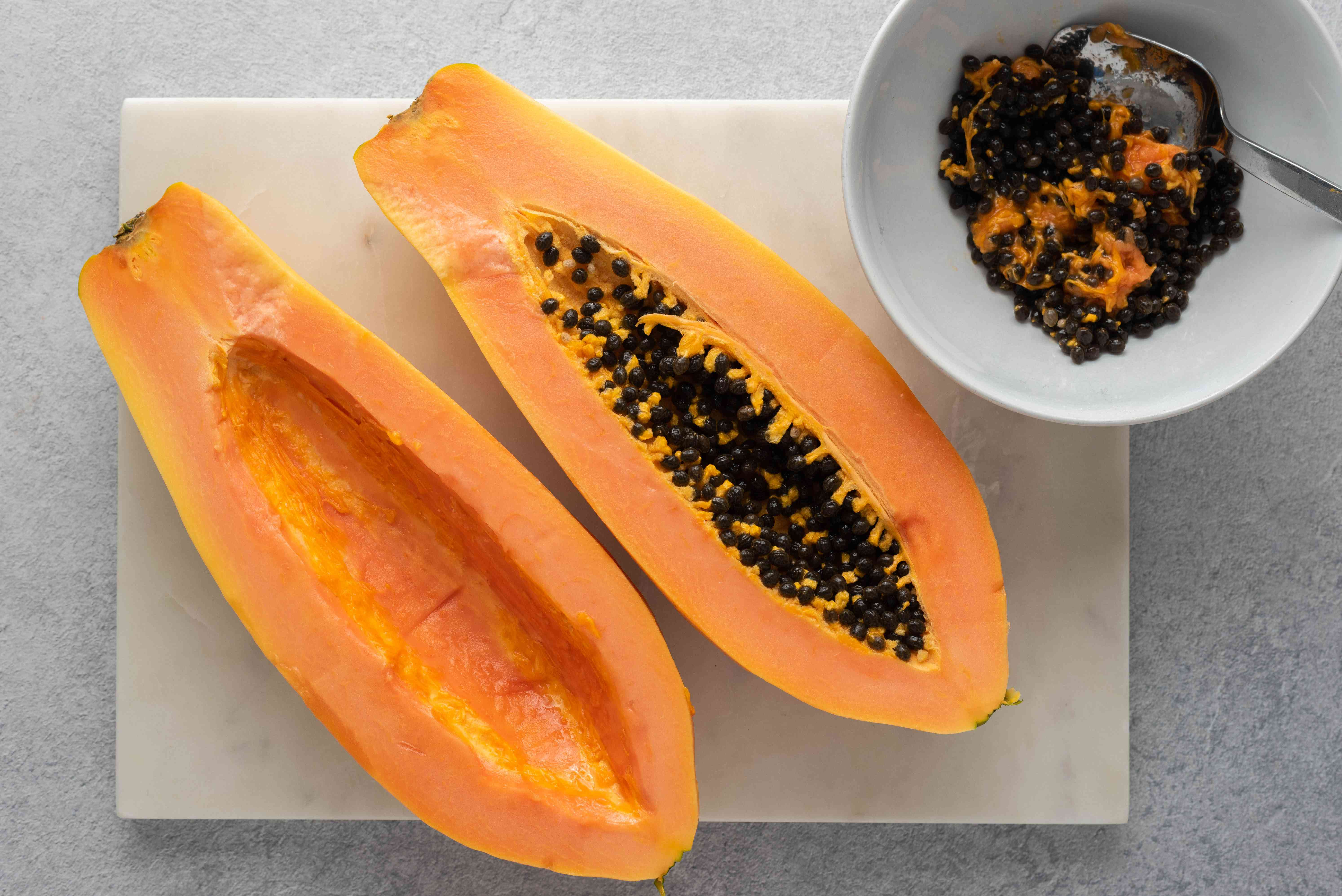 papaya cut in half with seeds removed