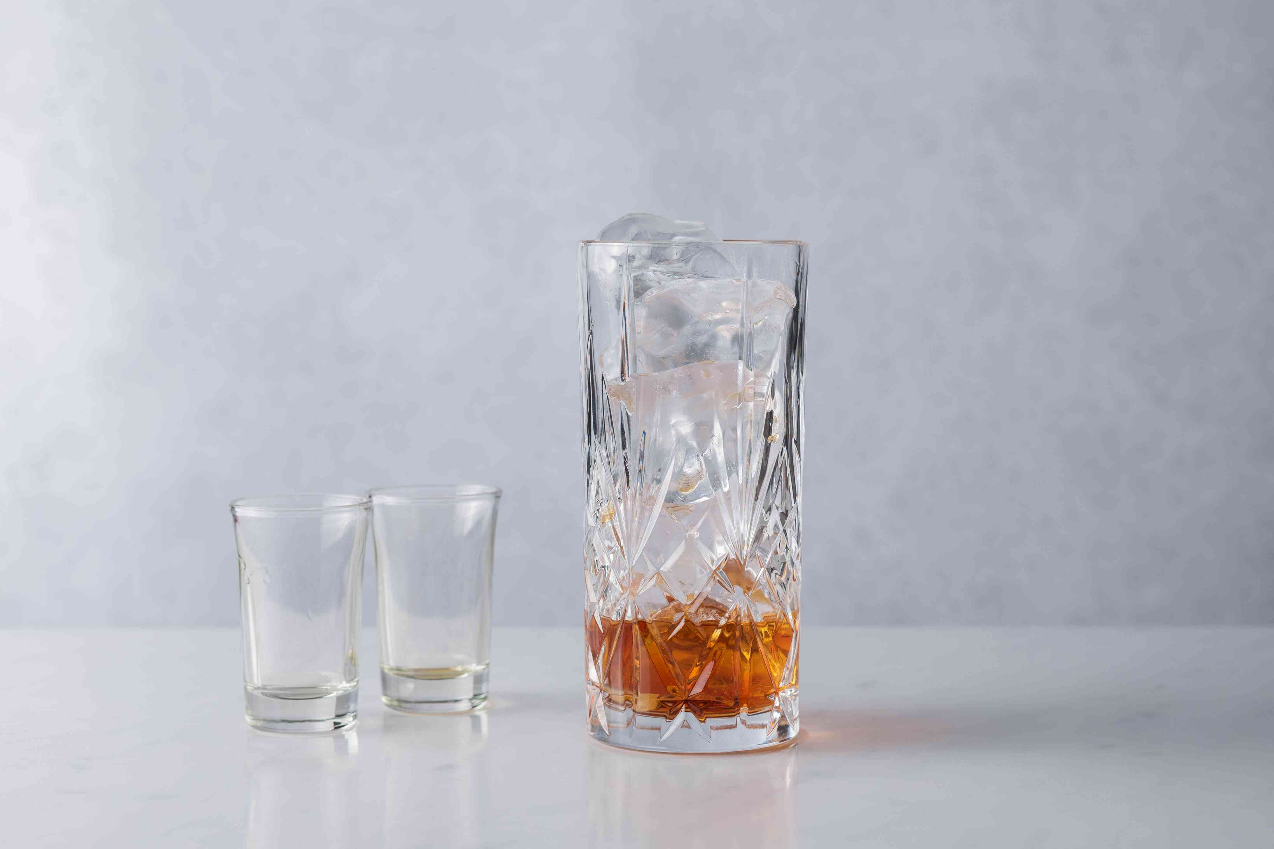 Add Licor 43 and rum to the glass
