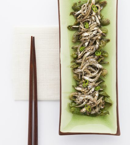 Fried anchovies on a long serving platter with chopsticks