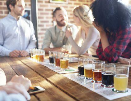 Tasting beer samples at brewery