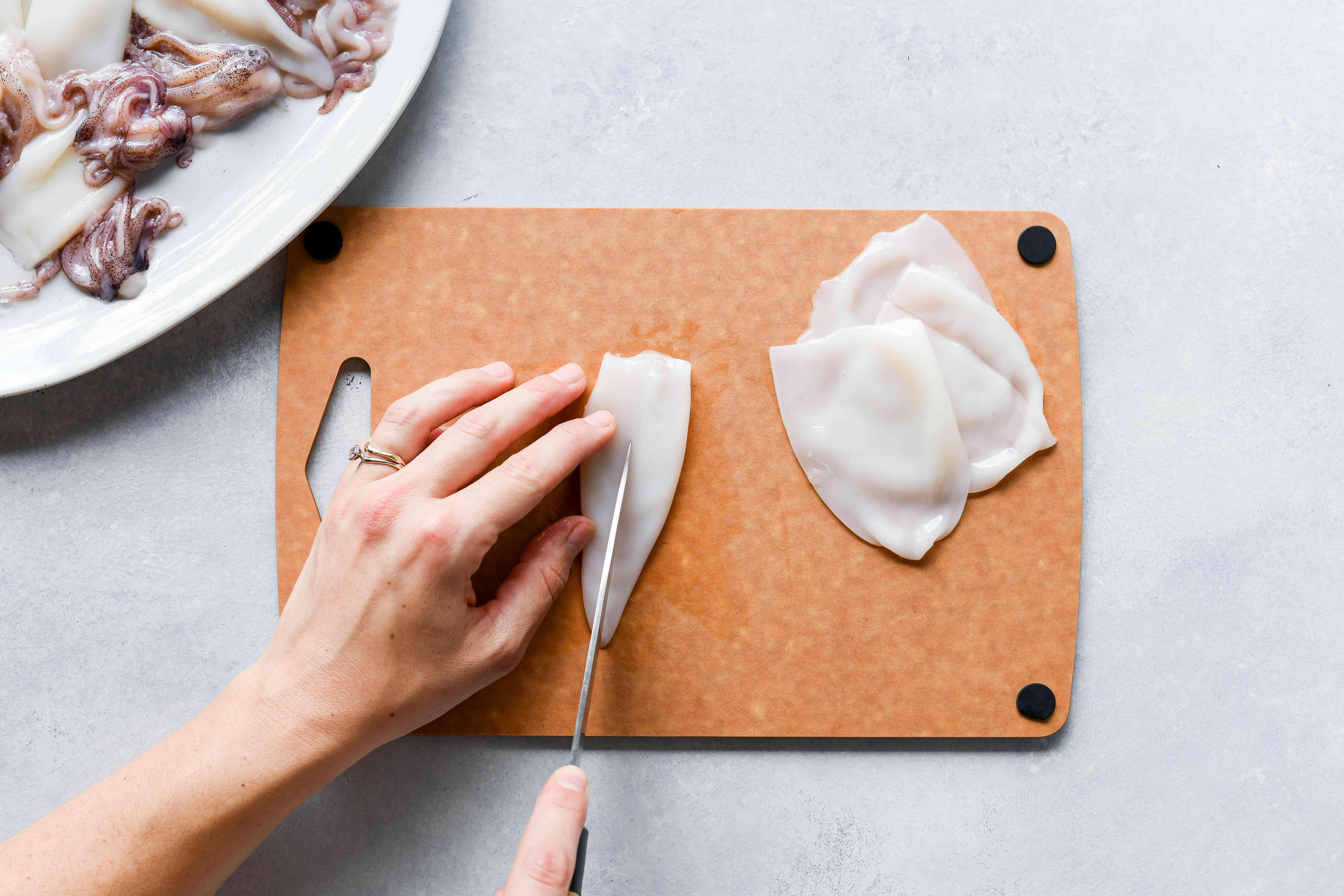 Cut squid bodies lengthwise down one side and open flat