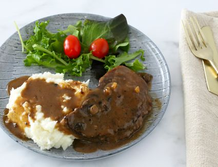 Slow cooker steak and gravy with mashed potatoes.