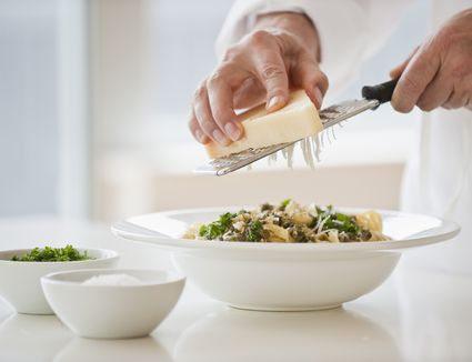 hands grating cheese - stock photo