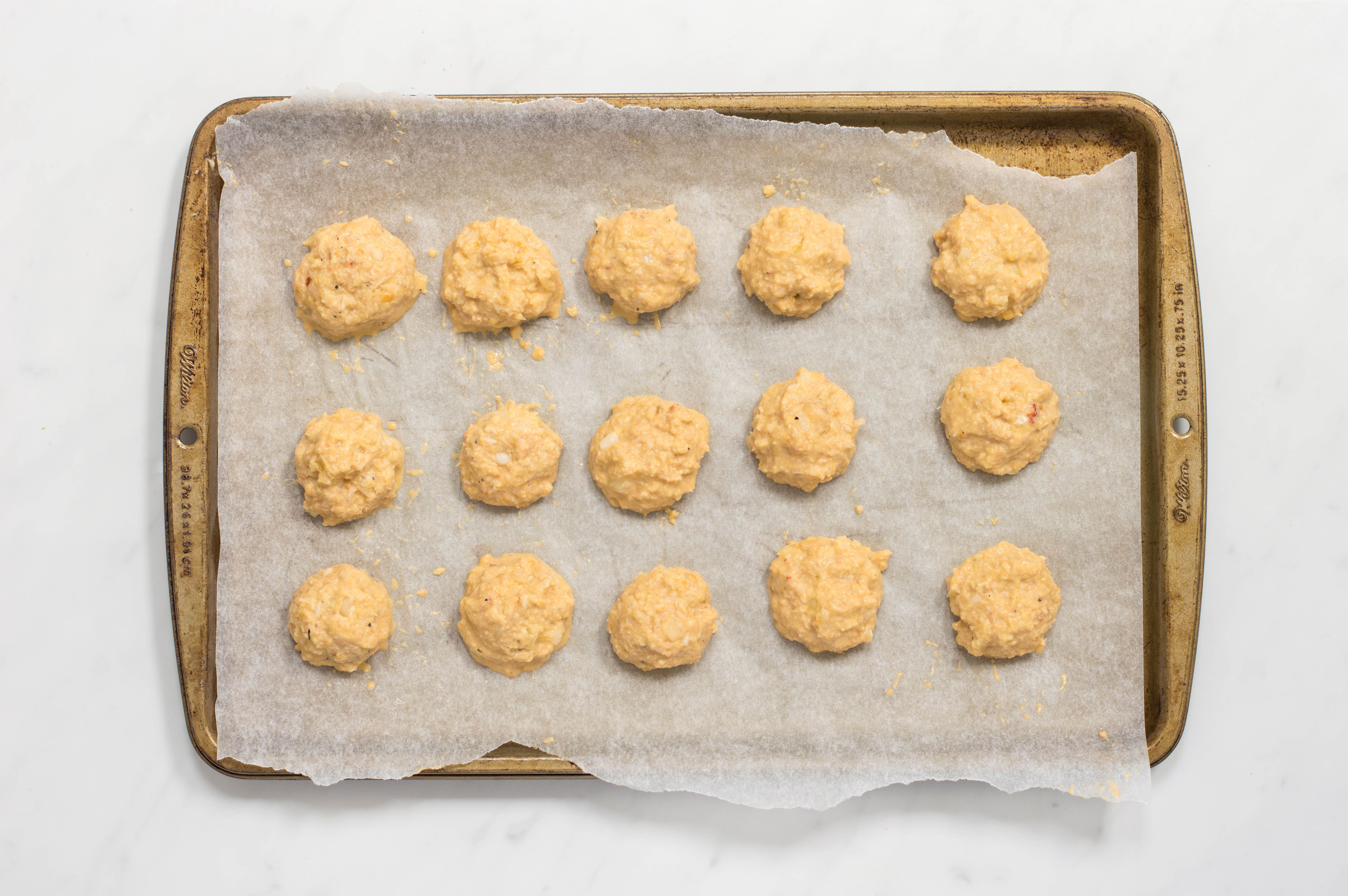 15 crabmeat balls on a baking tray