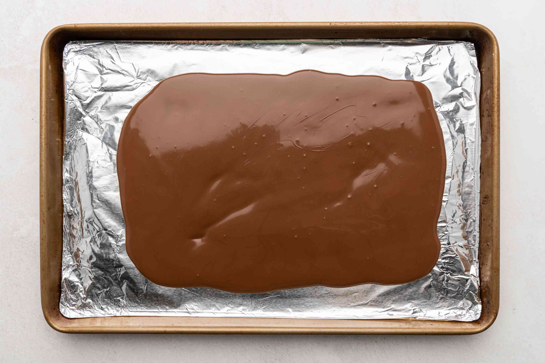 chocolate on an aluminum foil lined baking sheet
