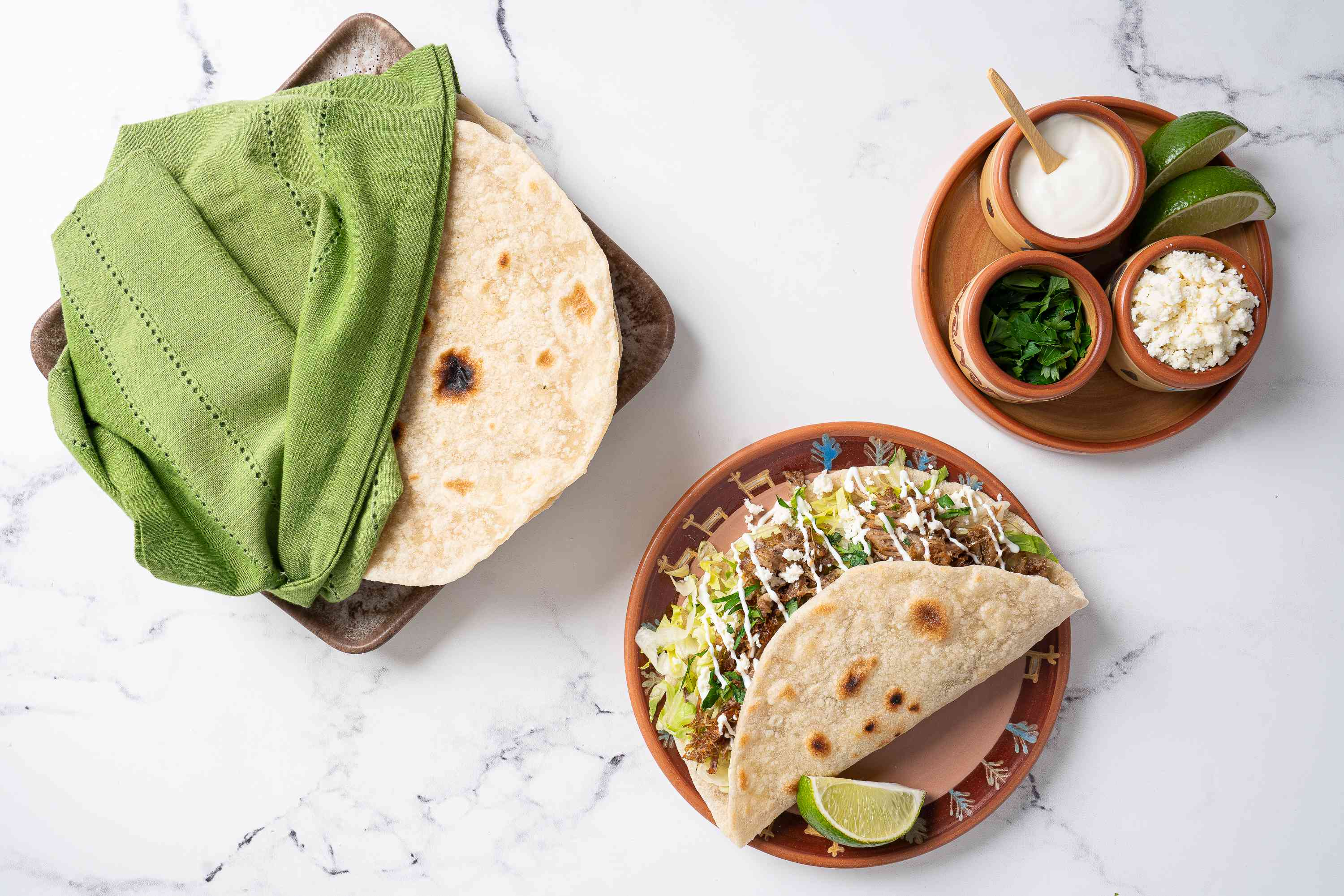 Homemade Flour Tortillas with tacos and fixings