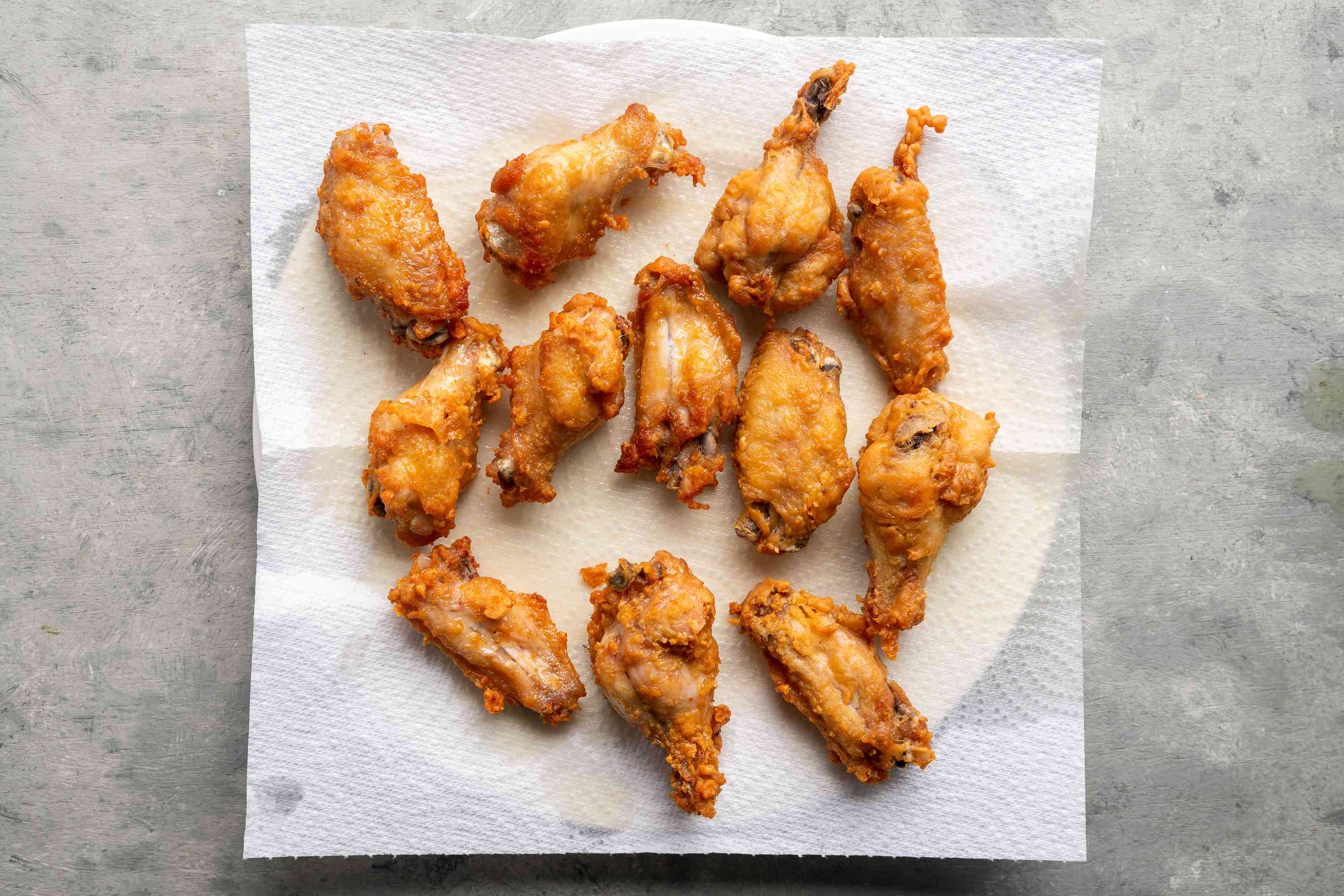 Fried chicken wings on a paper towel