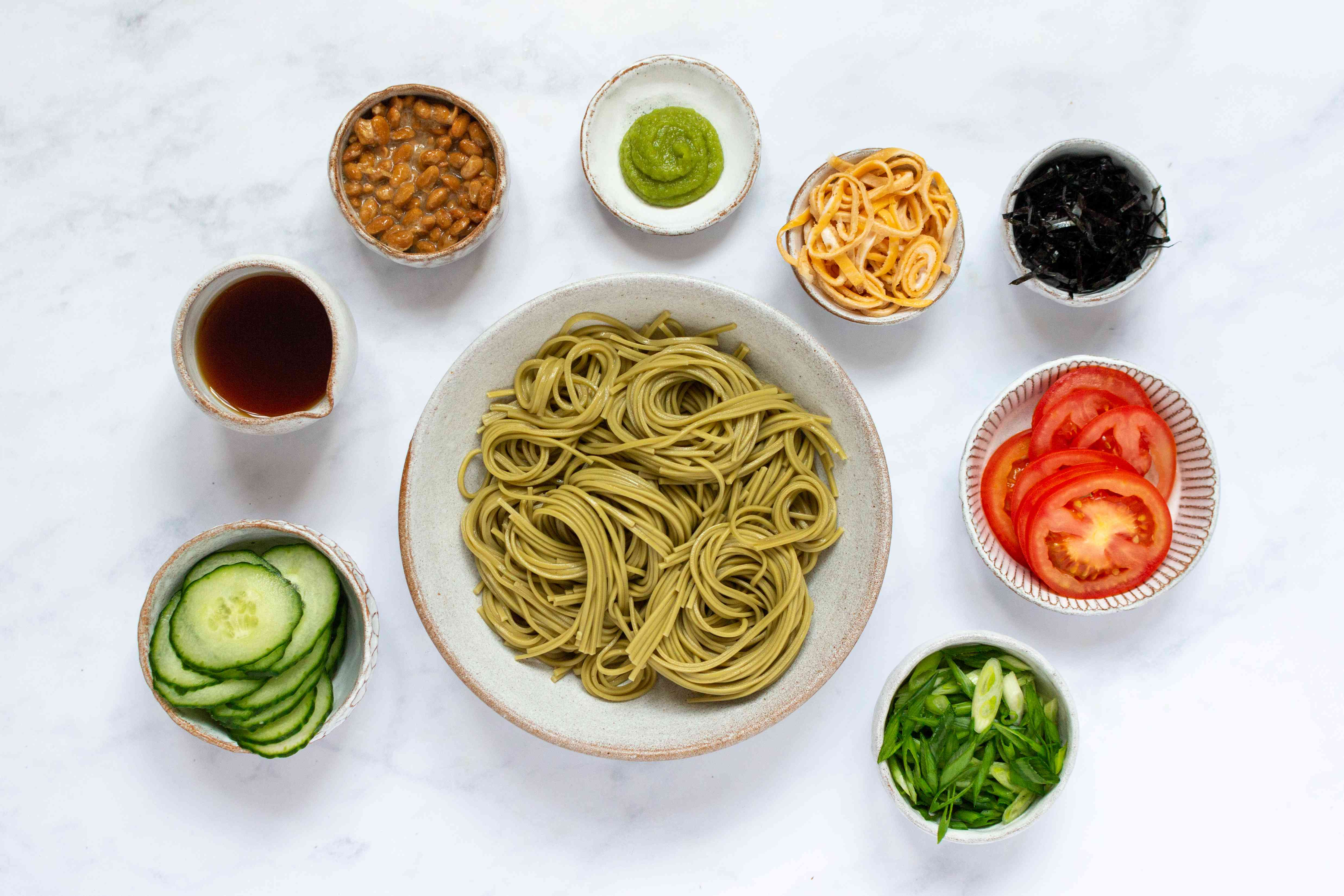 Cold Green Tea Soba Noodles (Cha Soba) with garnishes on the side