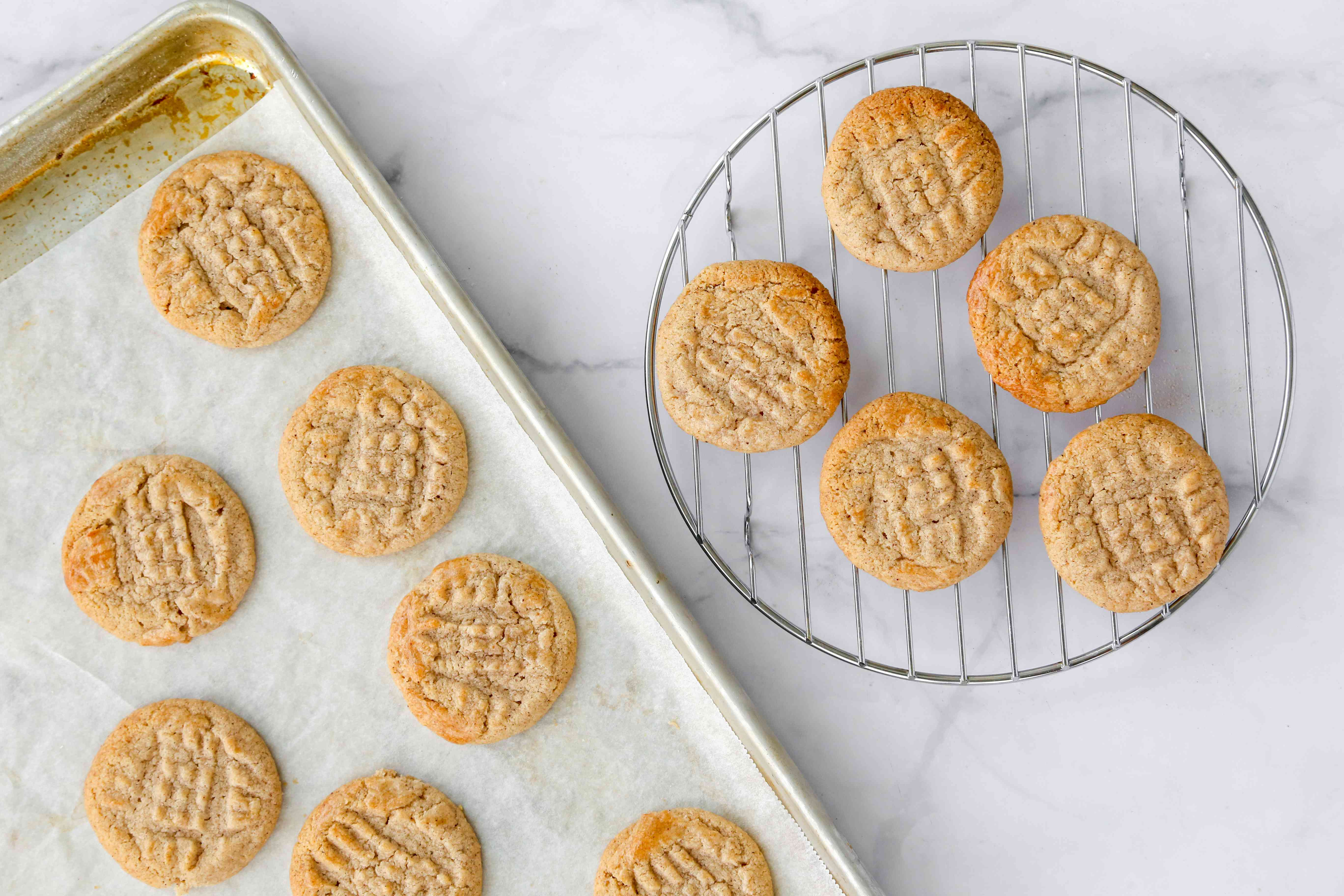 Cinnamon Ghoribas: Easy Cinnamon Cookie Recipe on a baking sheet and a cooling rack