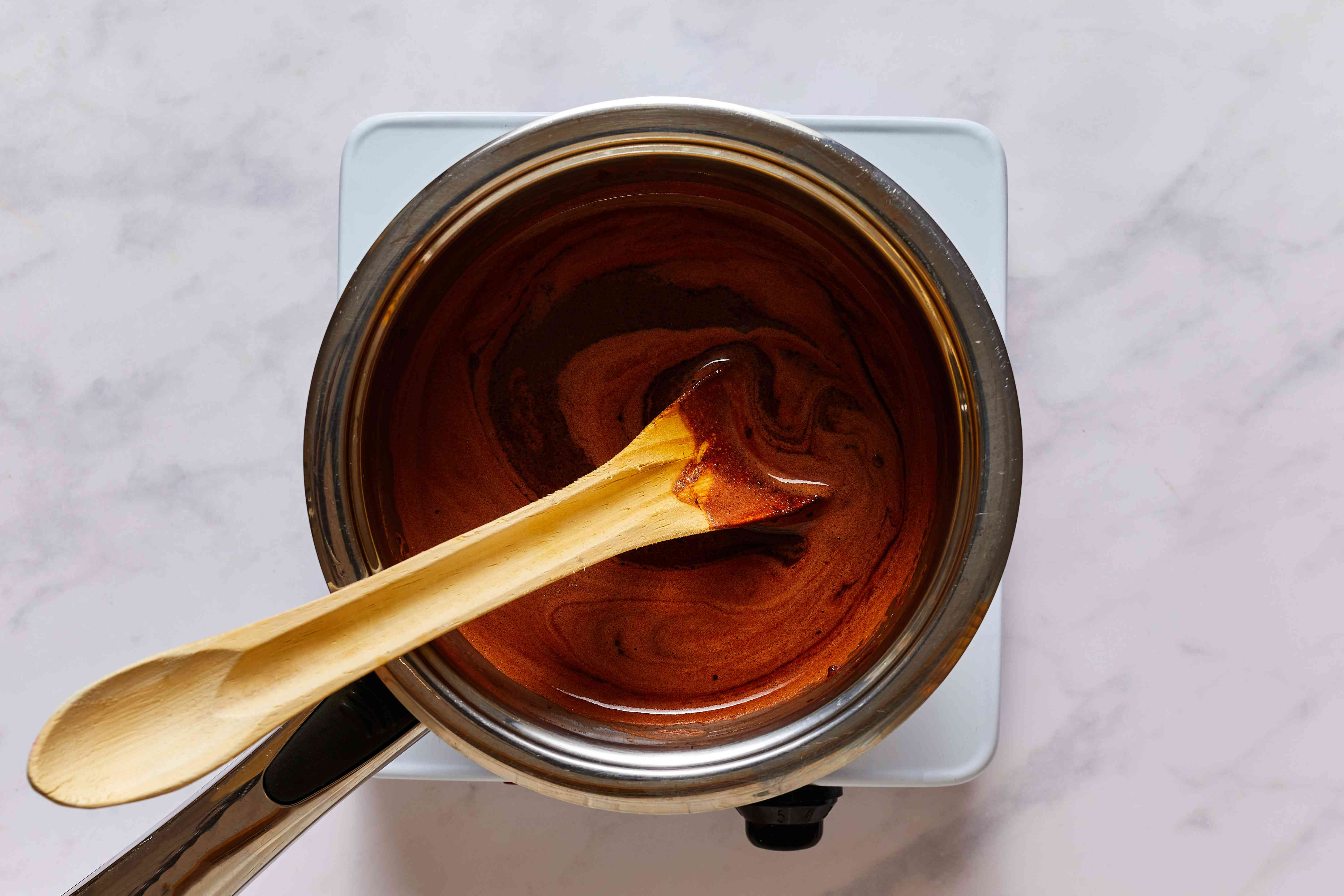 combine the butter, shortening, coffee, and cocoa in a saucepan