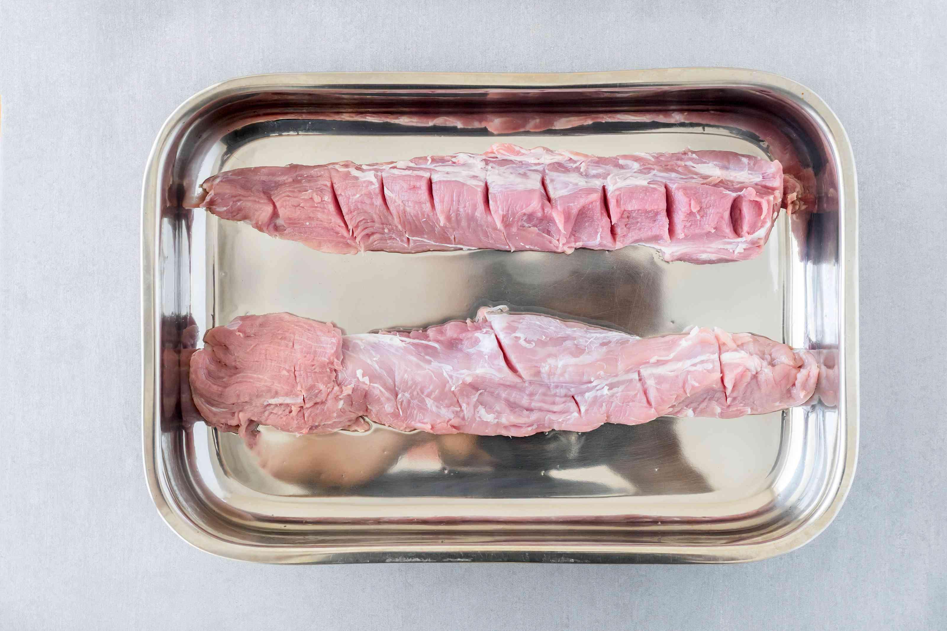 Place pork tenderloin in pan