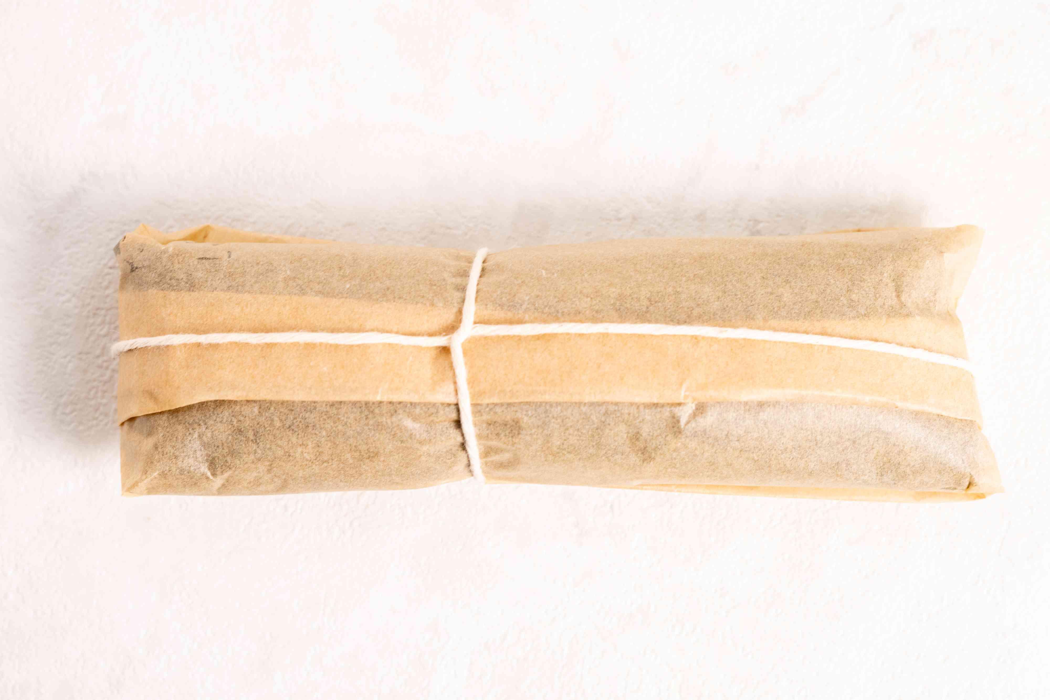 tie string around the parchment paper