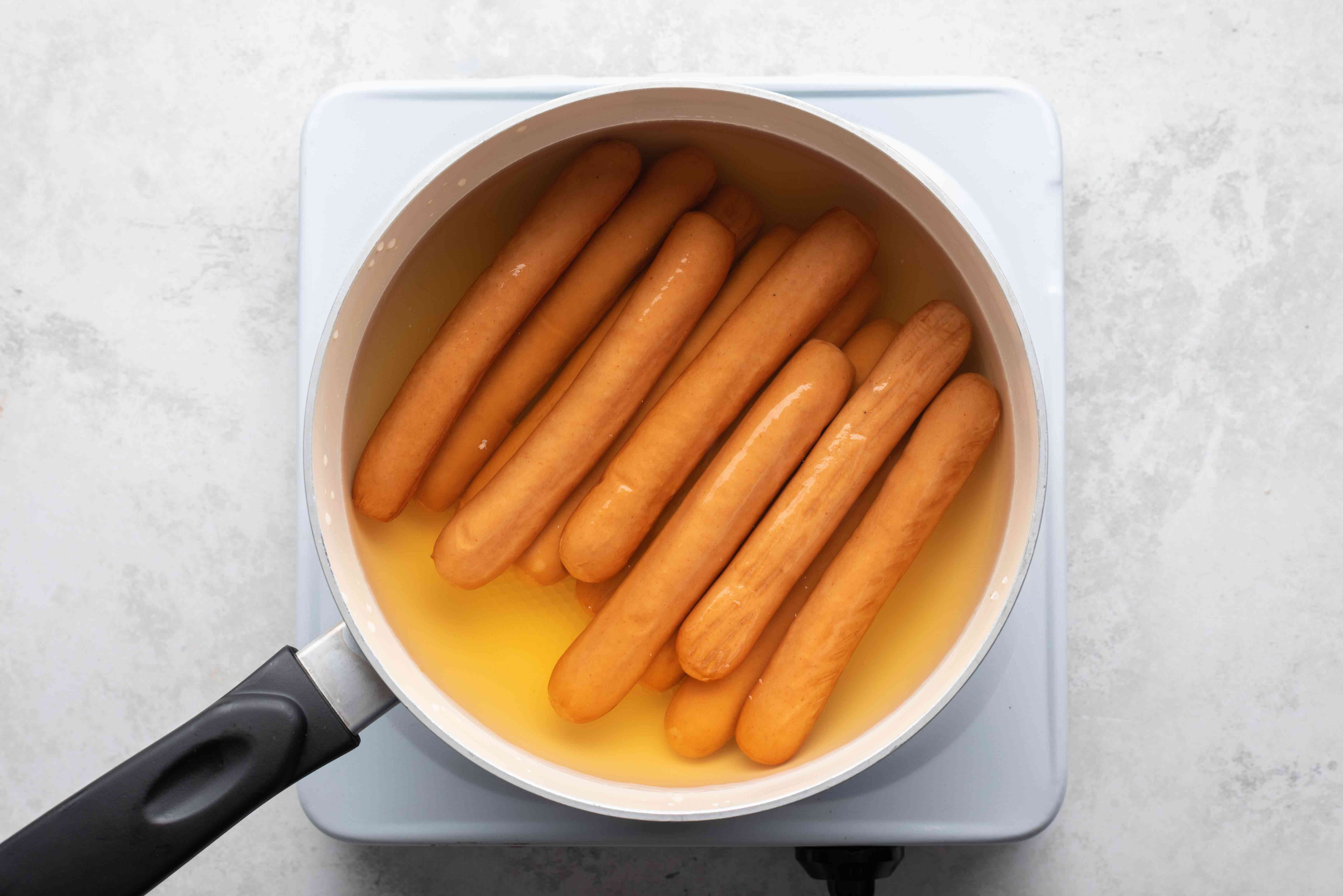 hot dogs in a pot with water