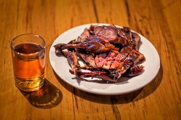 Pickled duck and a small glass of Shaoxing wine