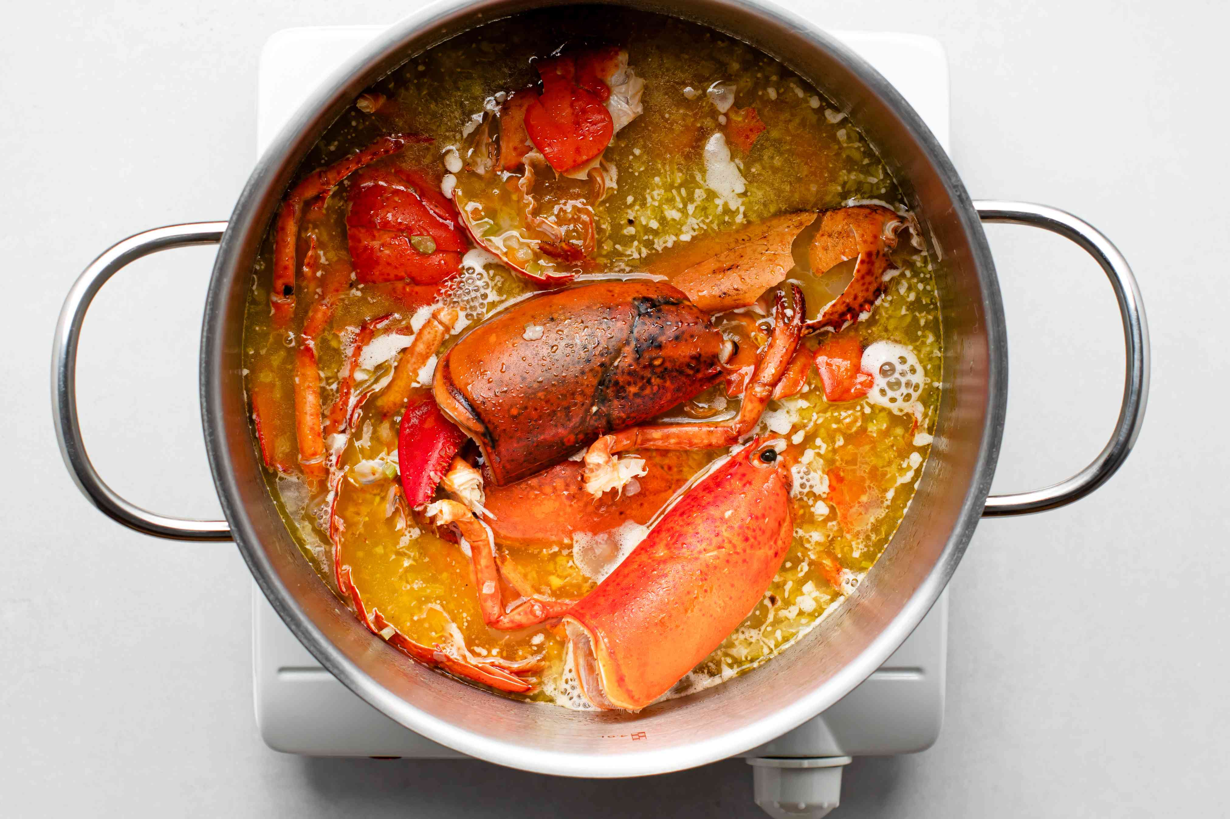 lobster shells and shrimp stock added to the stockpot mixture
