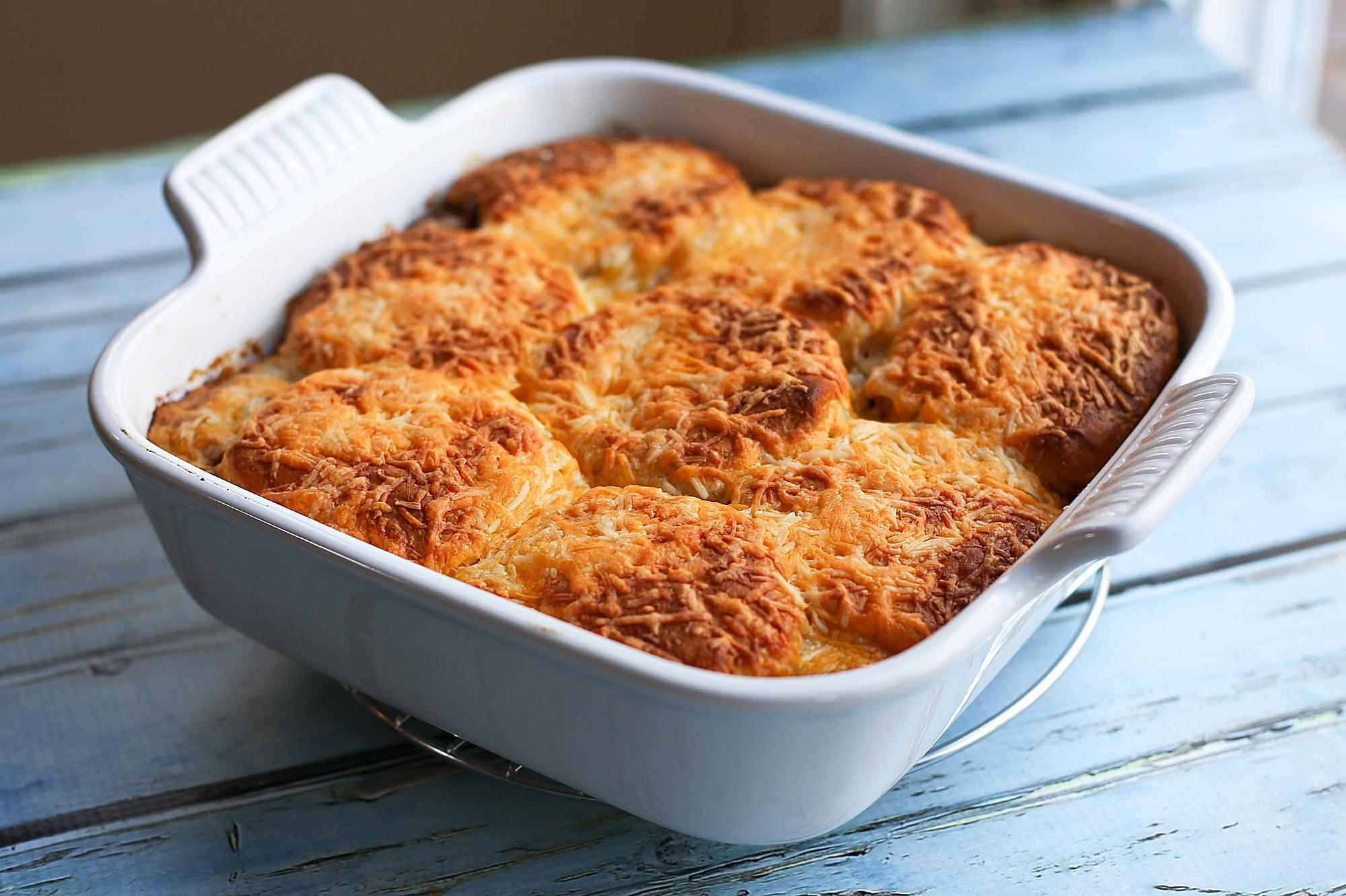 Tex-Mex style beef and biscuit casserole topped with a sprinkling of cheese