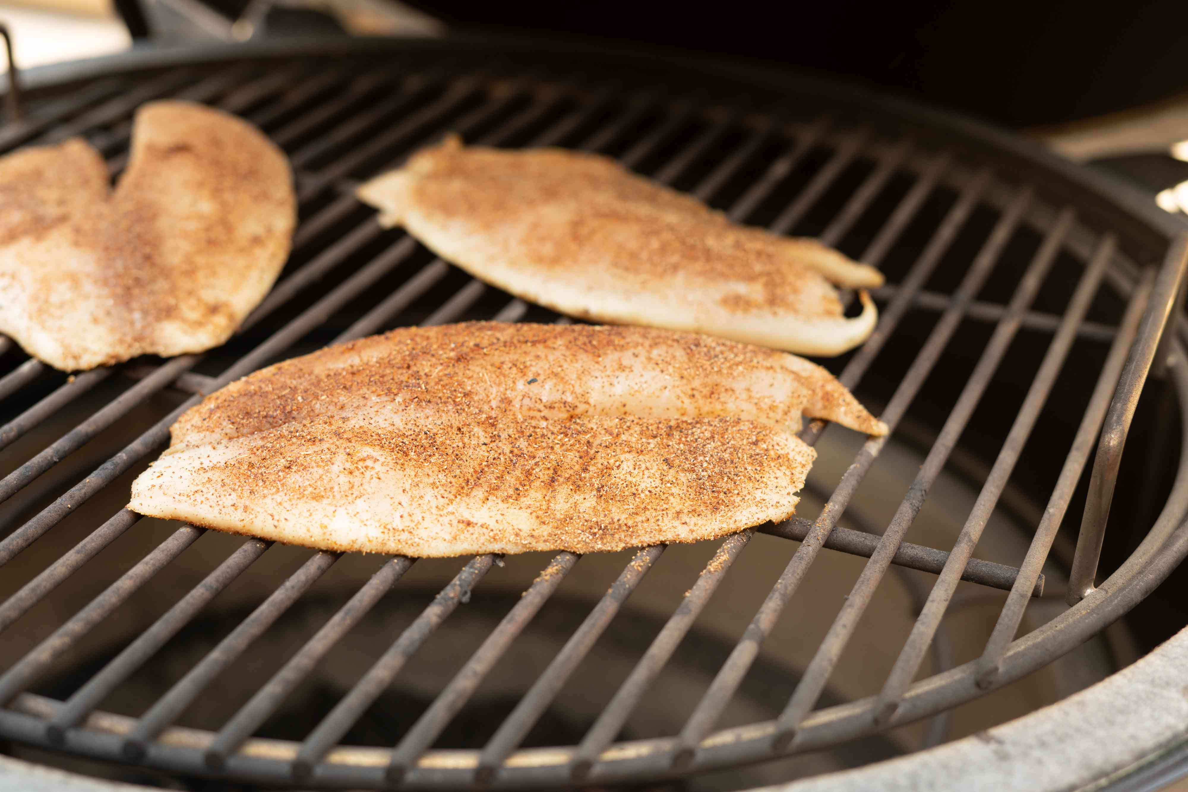 tilapia cooking on the grill