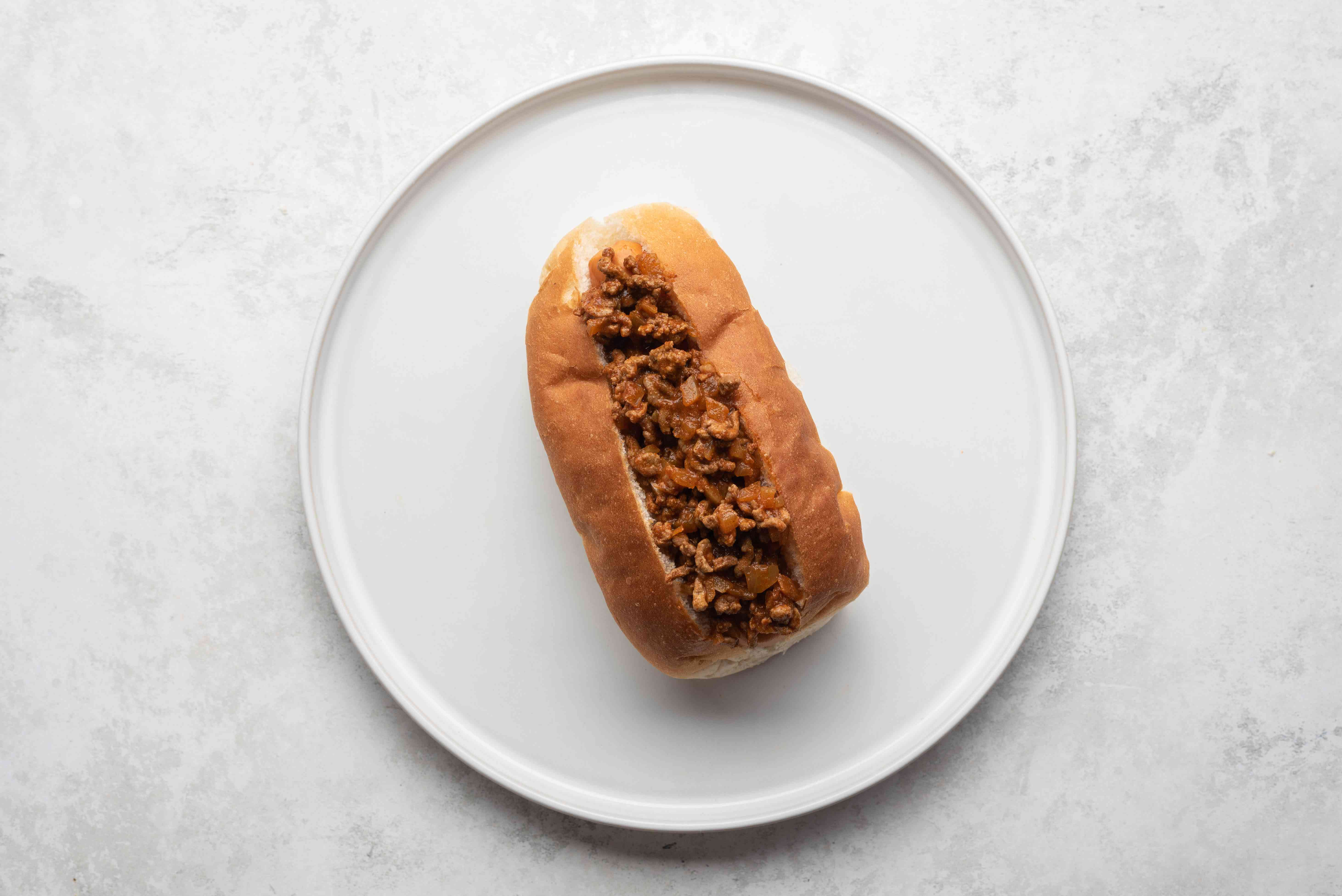hot dog with beef mixture on top