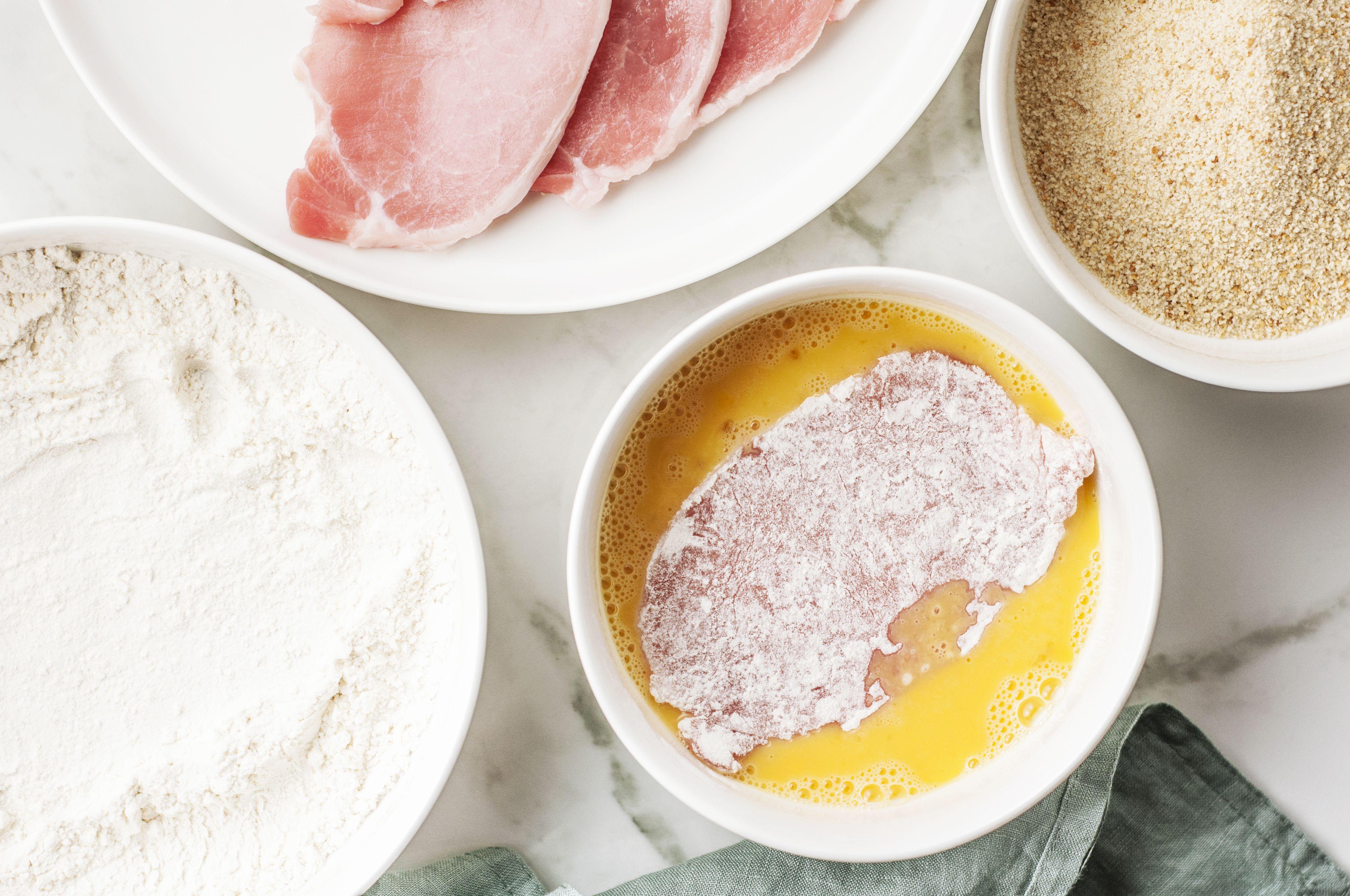 floured cutlet in beaten eggs