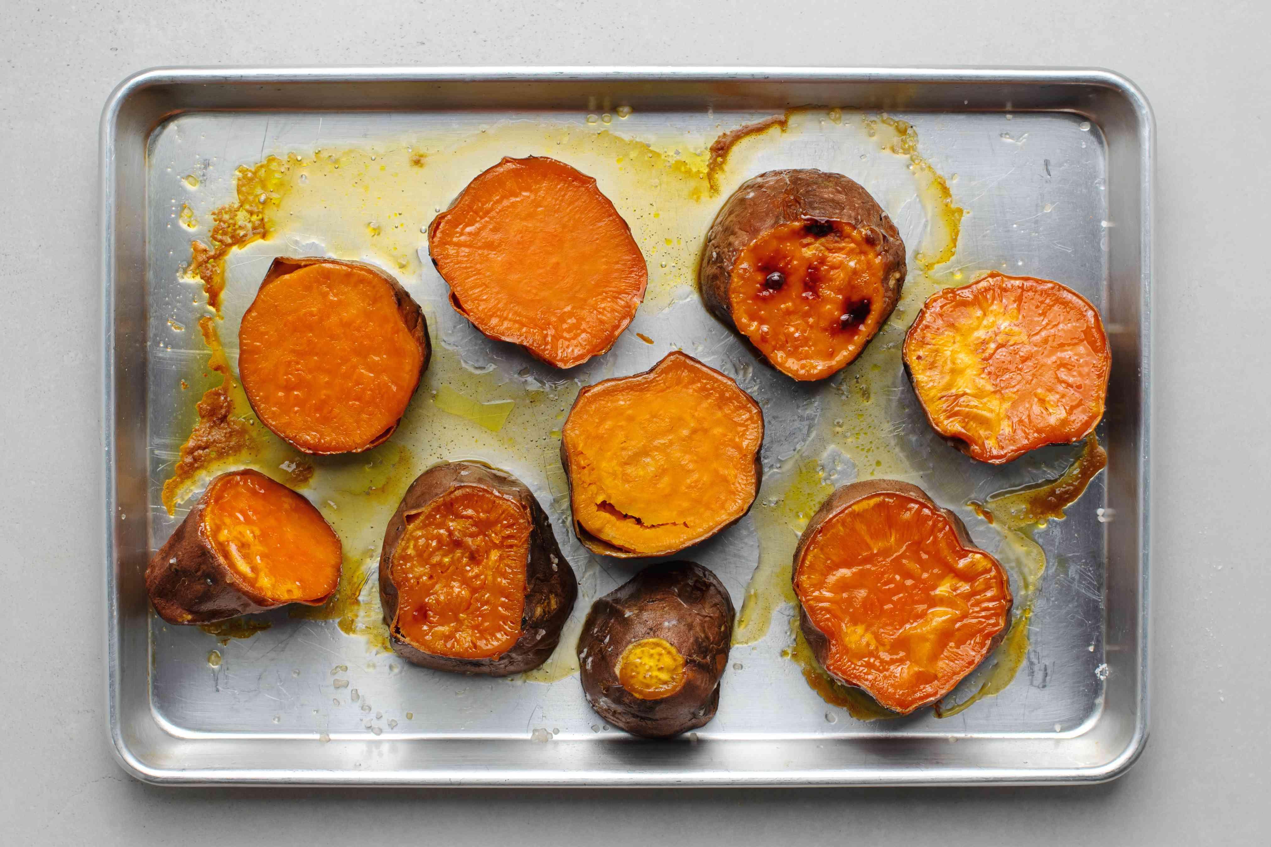 baked sweet potato pieces on a baking sheet
