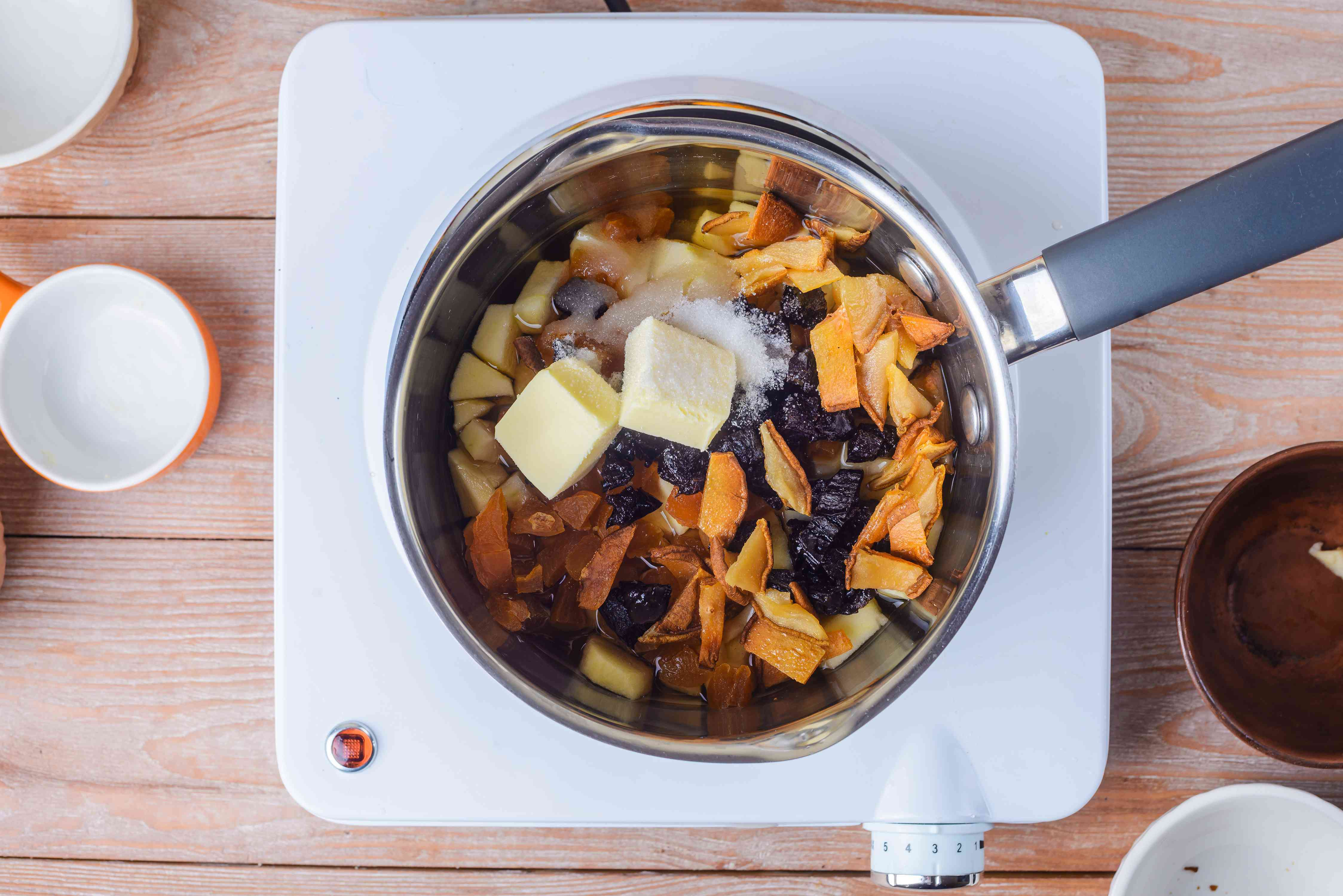 Bring butter, sugar, and pears to boil