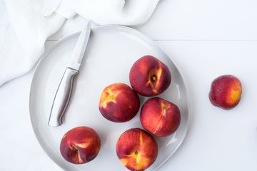 peaches on plate with knife