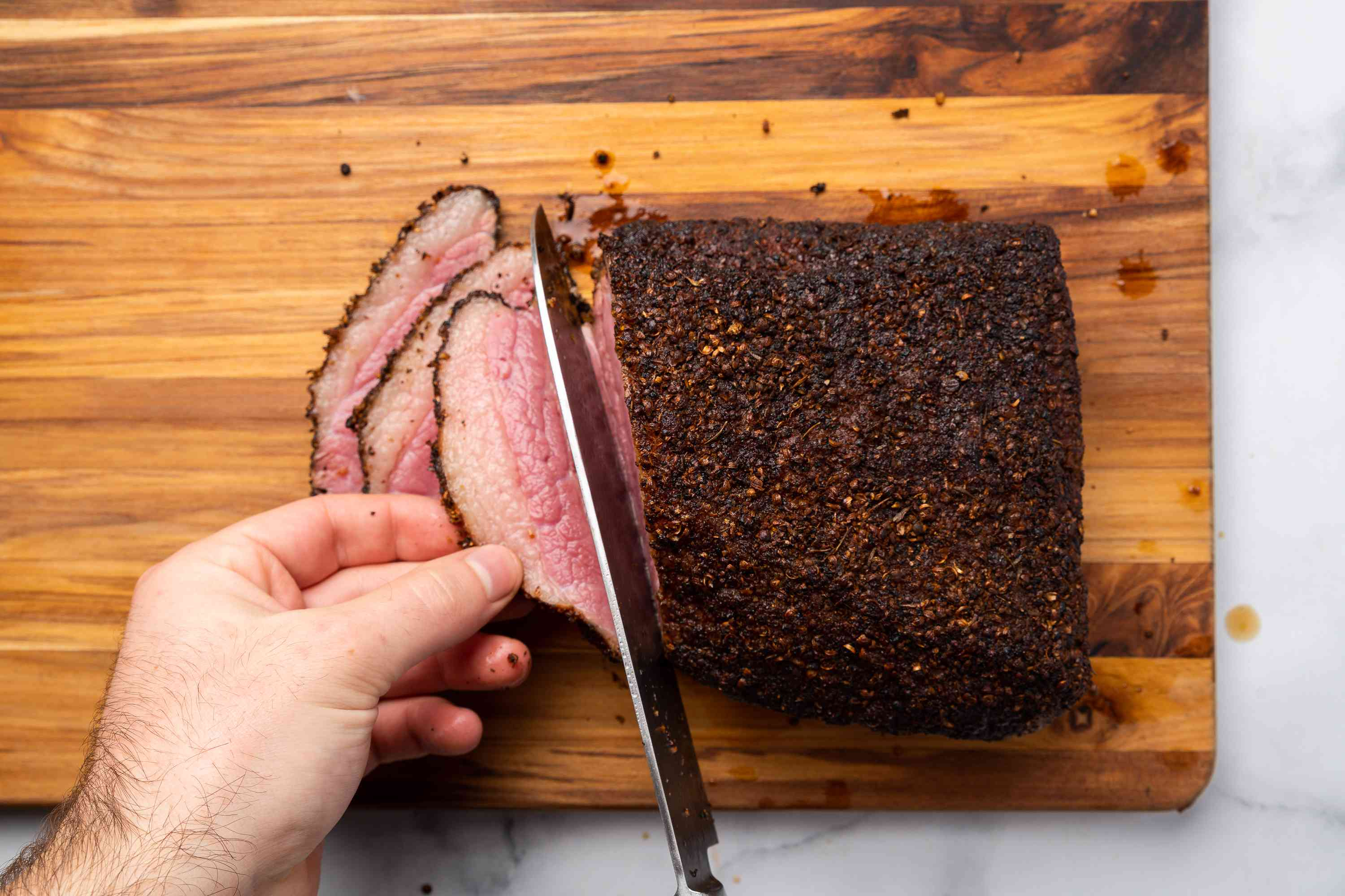 Smoked corned beef sliced on a cutting board
