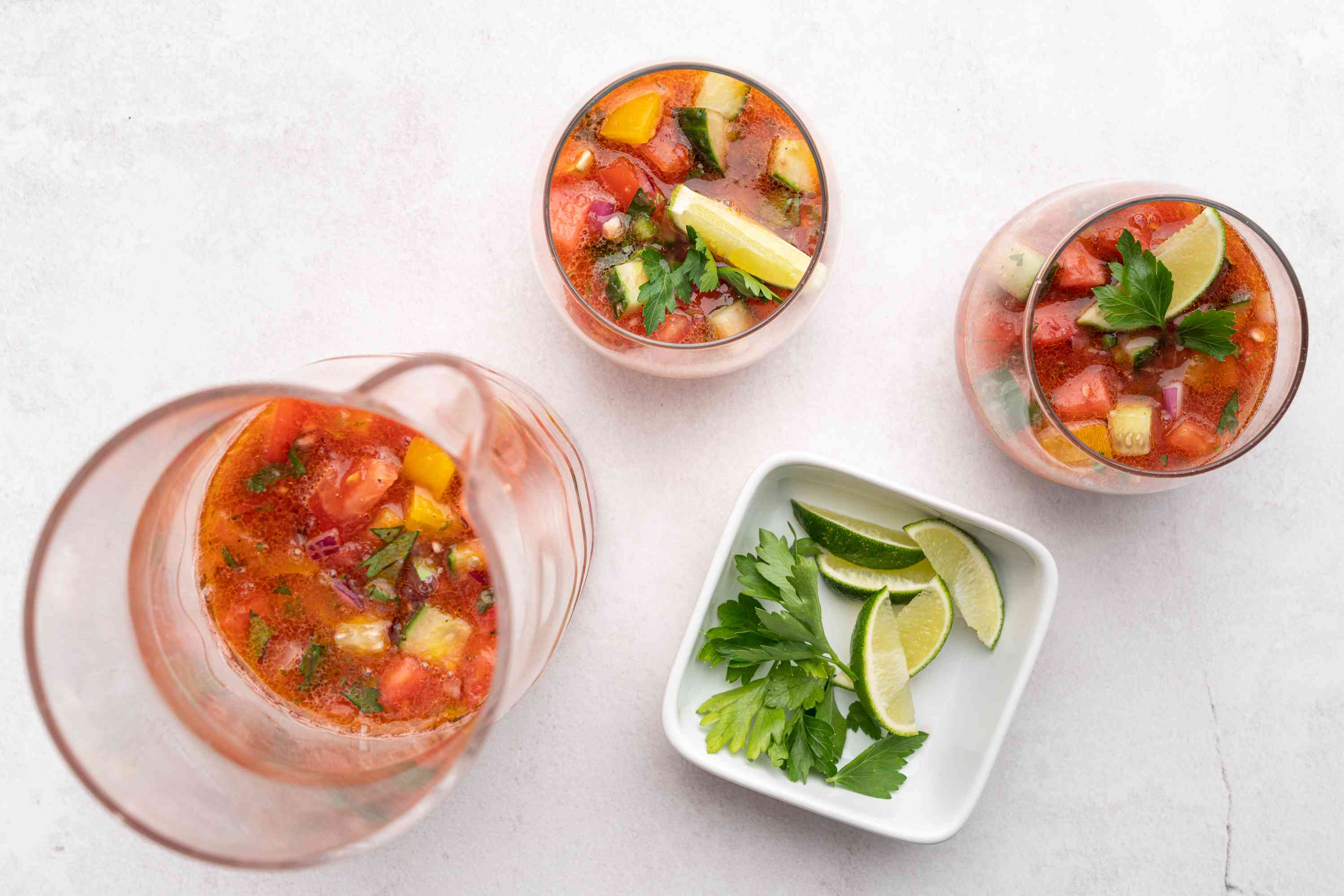 Watermelon Gazpacho Soup in glasses, served with lime wedges