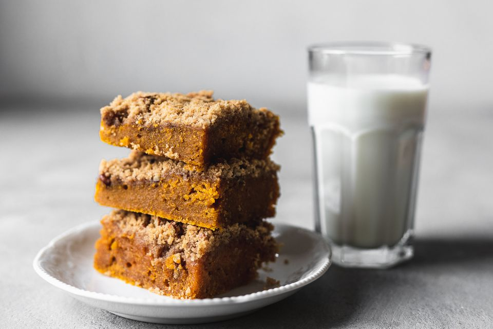 Pumpkin Bars With Streusel Topping on a plate with a glass of milk