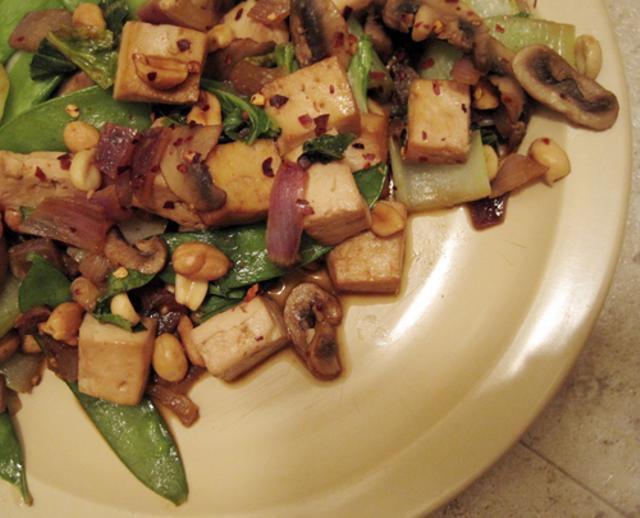 Kung pao tofu with mushrooms, bok choy, and snow peas
