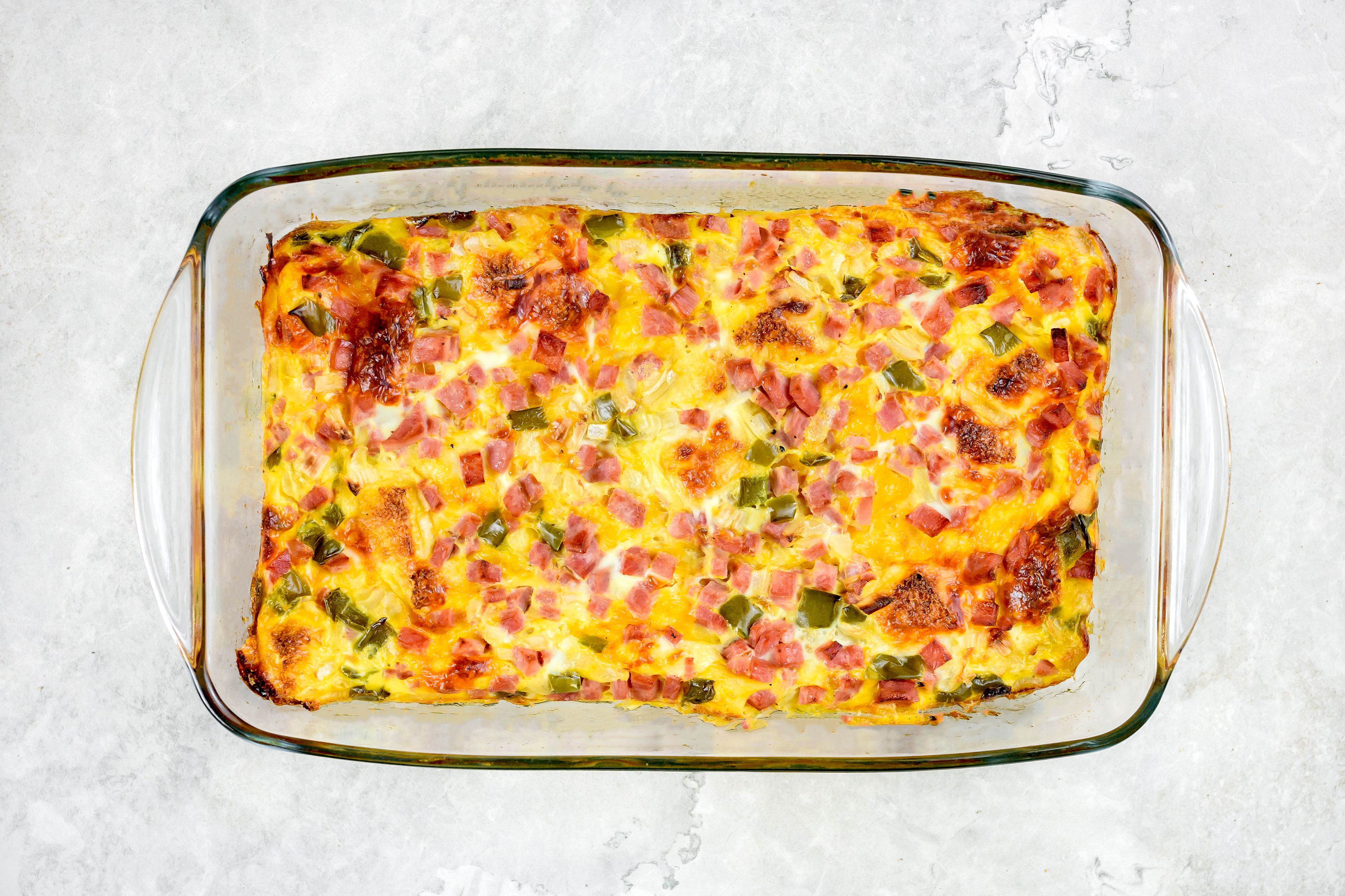 Baked western ham and egg casserole in dish