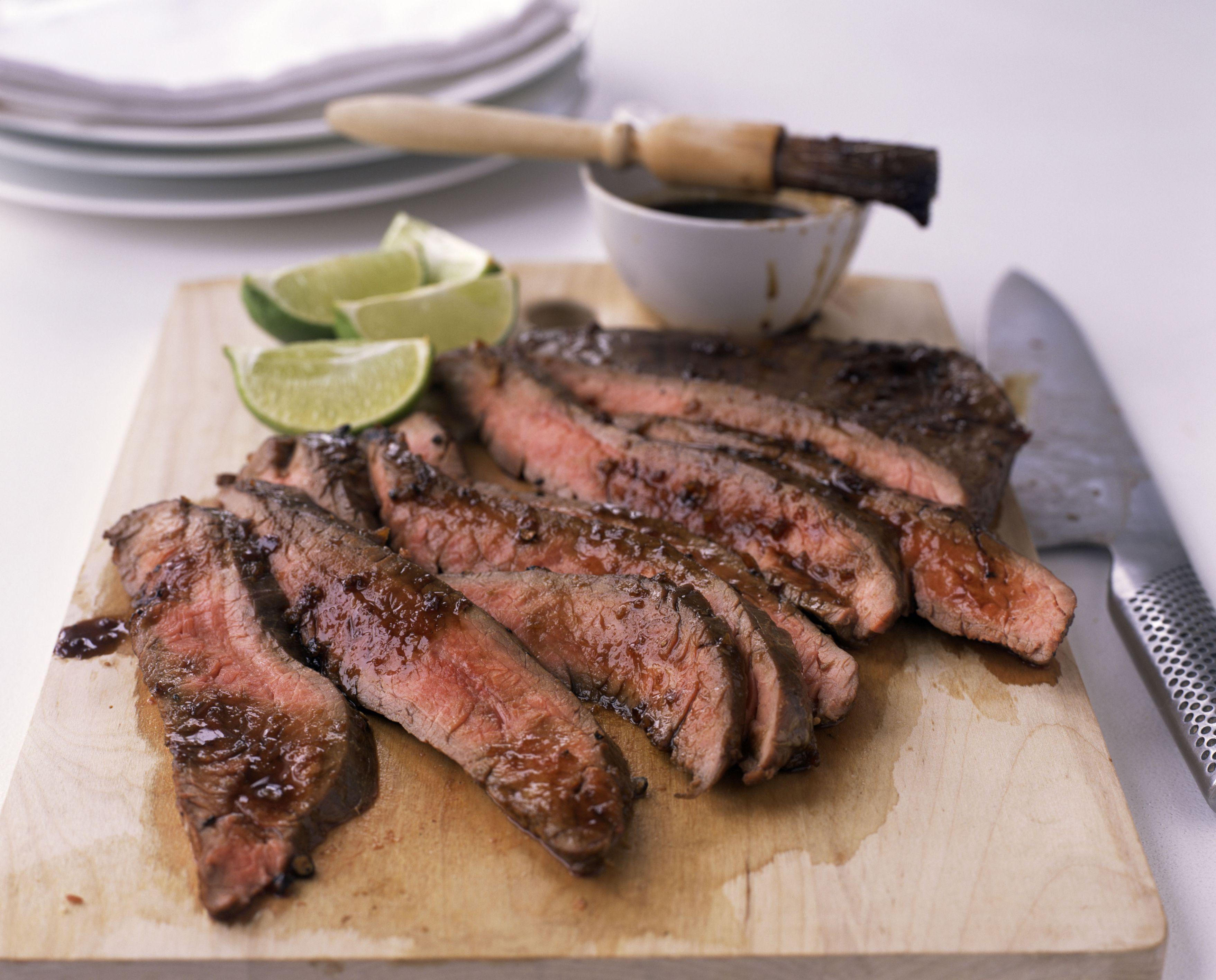 Sliced flank steak with au jus sauce