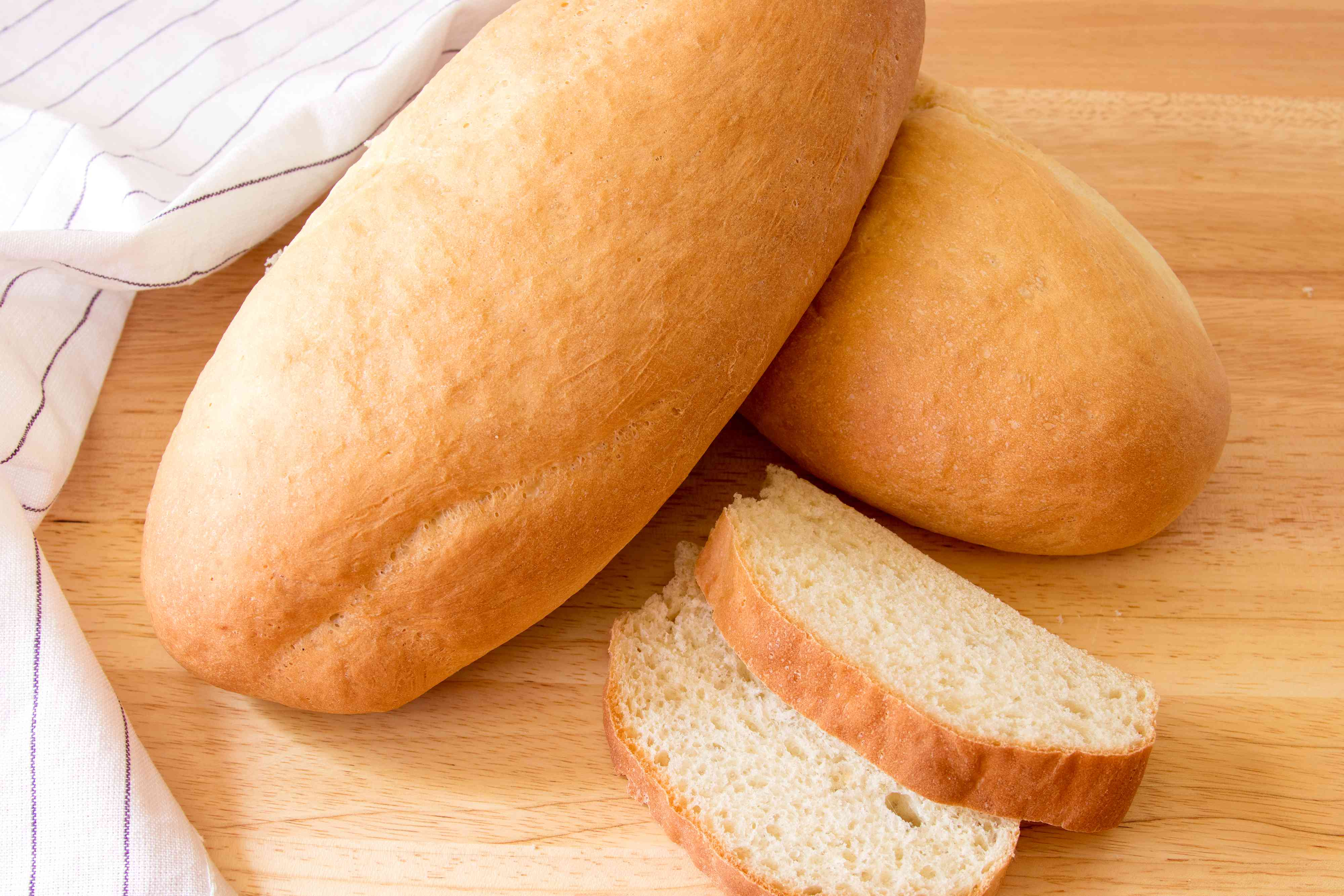 Puerto Rican pan sobao bread, whole and sliced