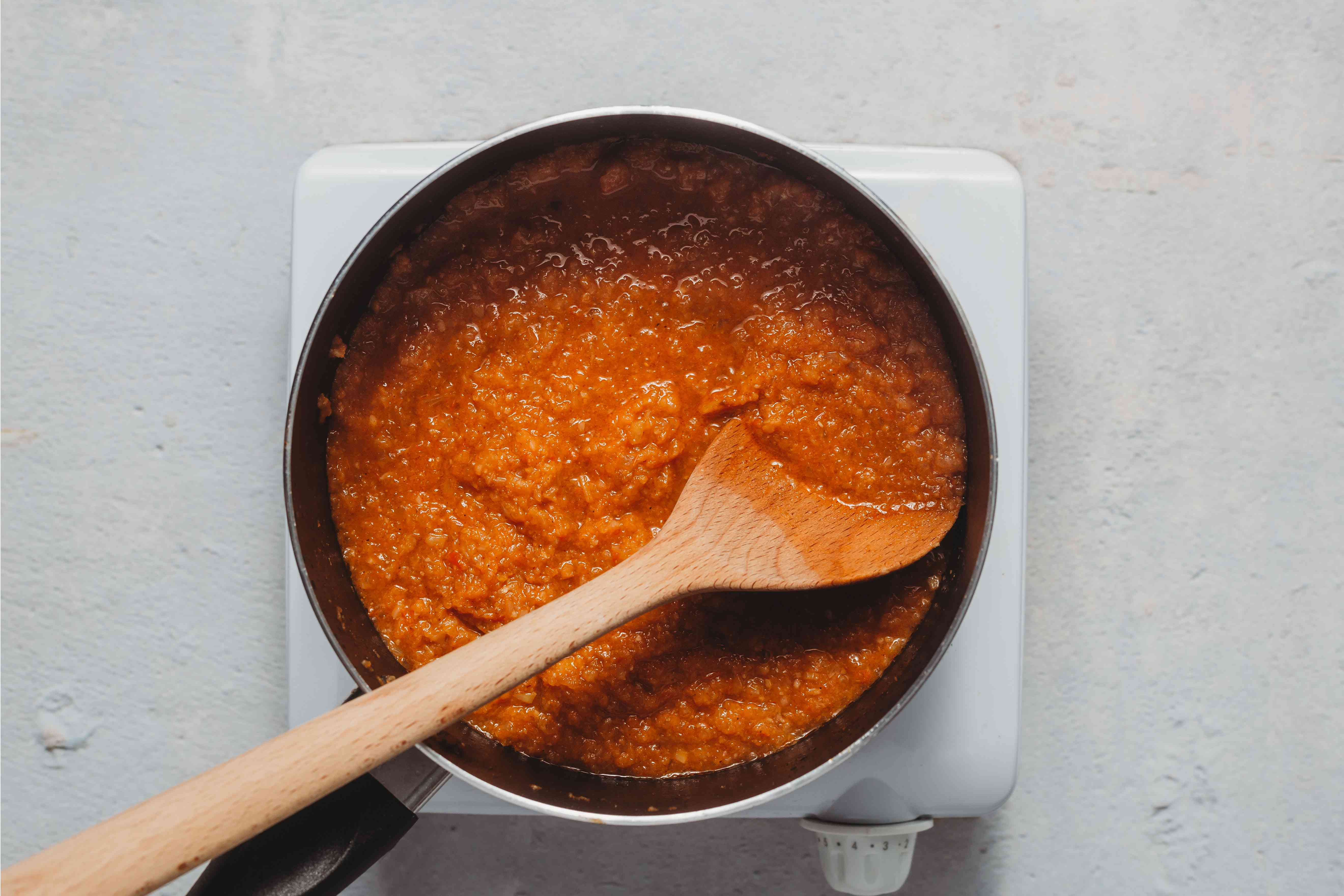 spice paste cooking in a pot