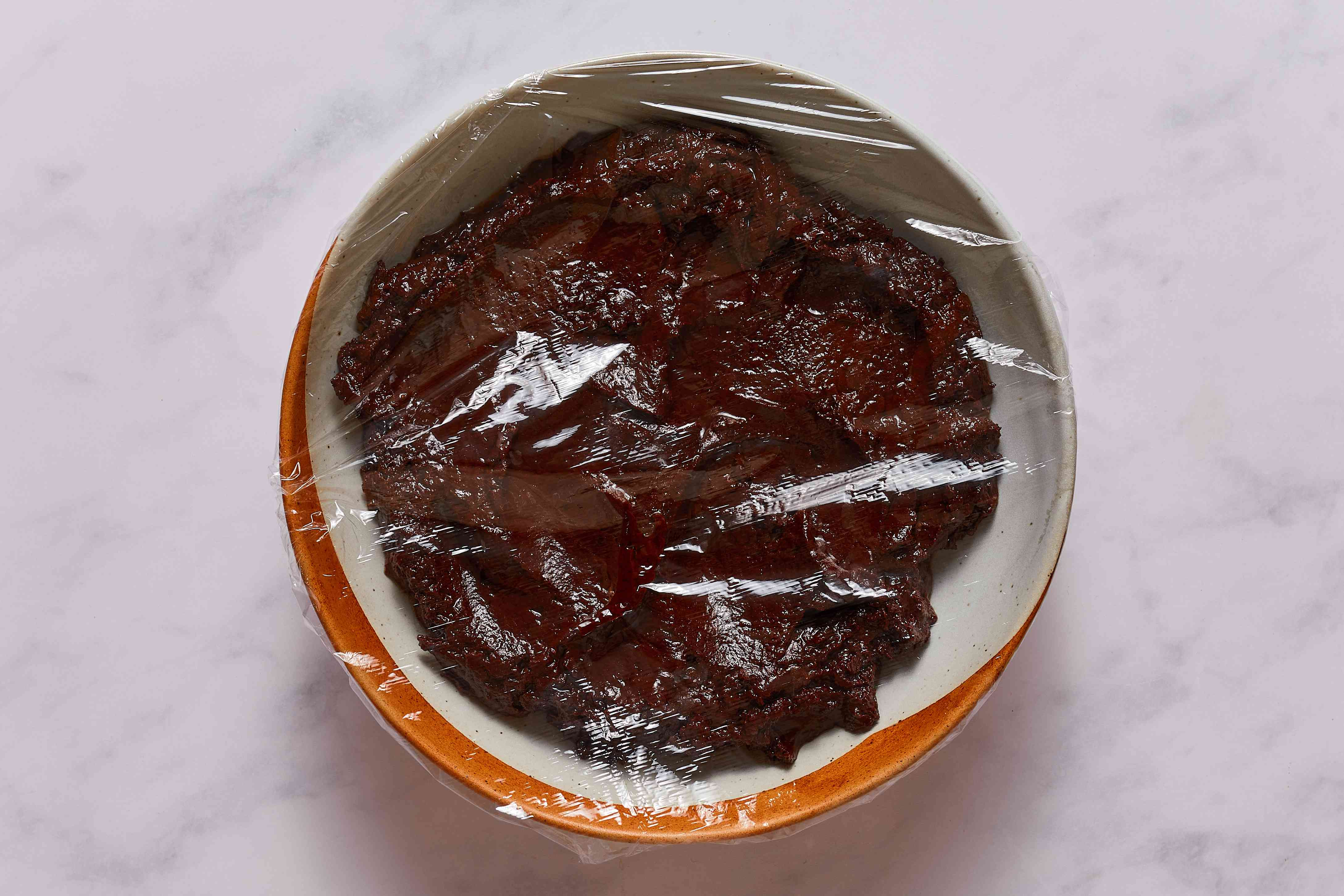 Pour the chocolate mixture into a medium bowl, and cover with plastic wrap
