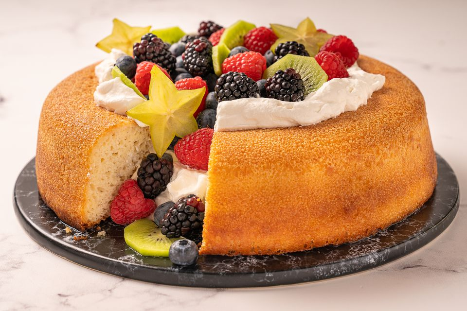 Savarin topped with whipped cream and fruit