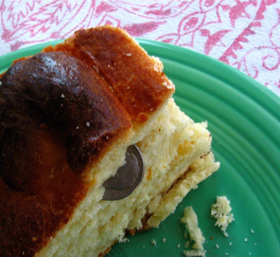 Greek vassilopita bread slice with lucky dime