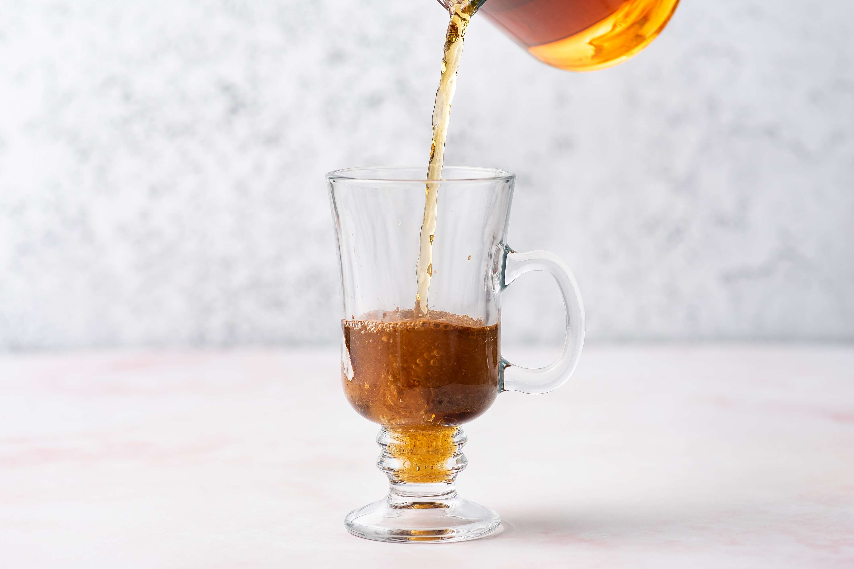 add tea to the Irish coffee mug with the spices