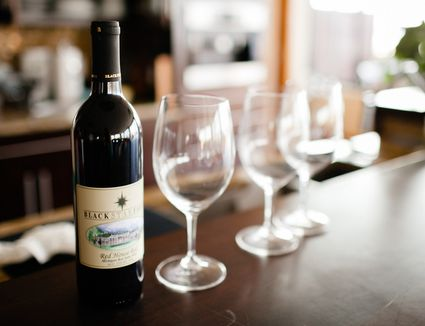 Bottle of wine and glasses on table