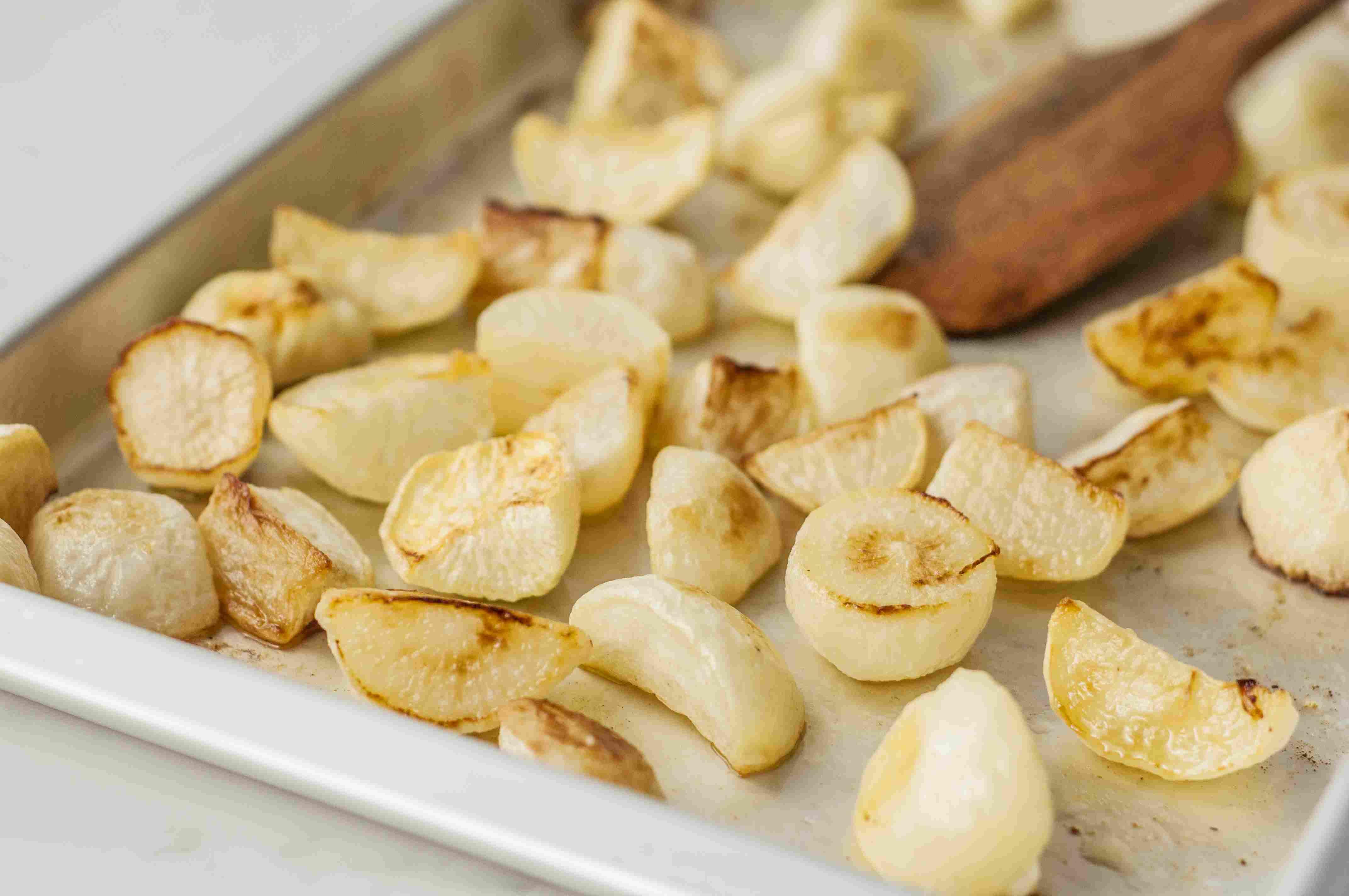 Roasted turnips on a baking sheet