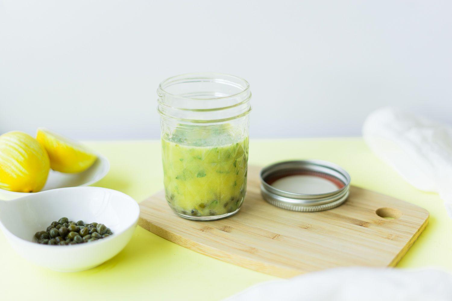 Lemon caper sauce in a glass jar