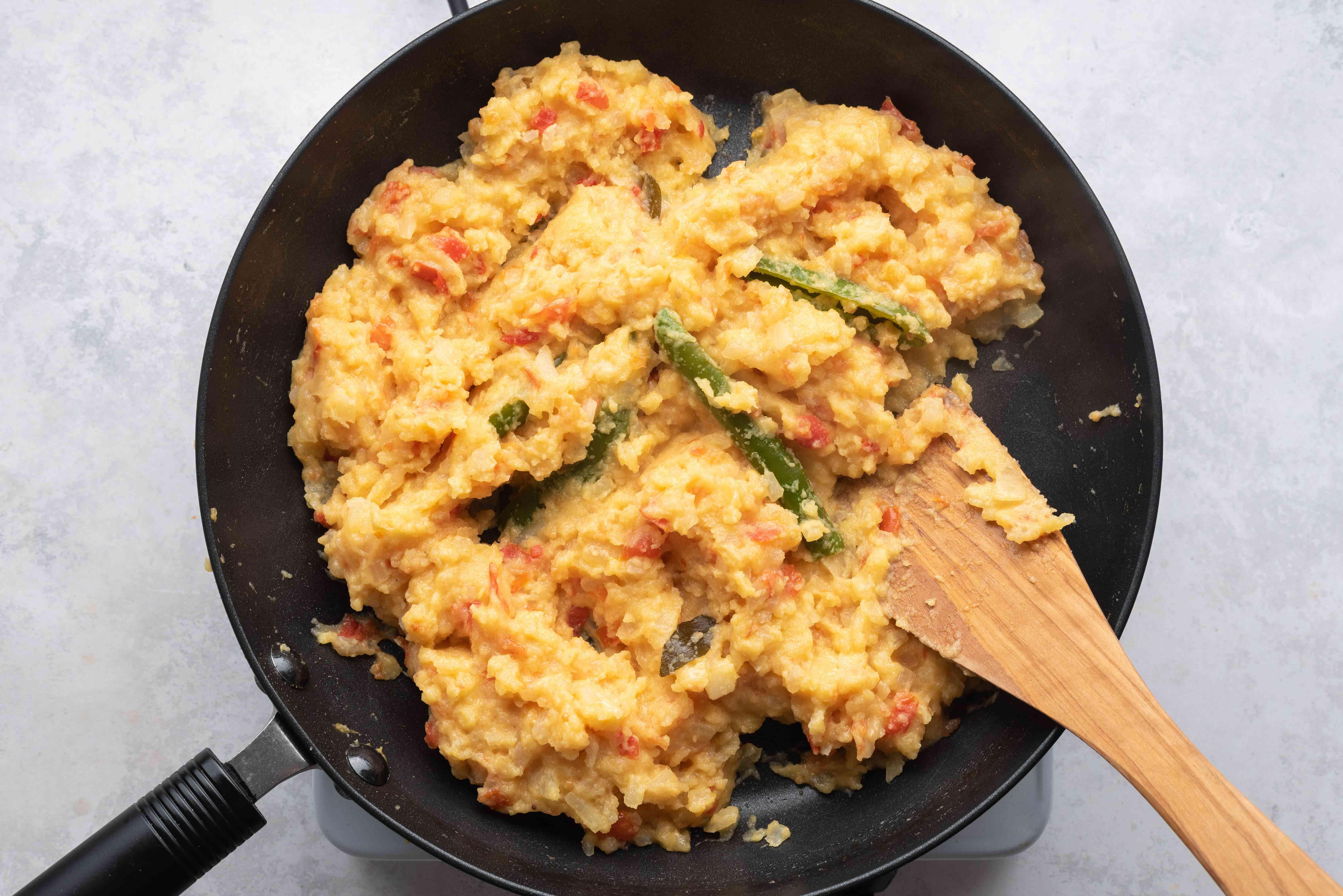 semolina mixture cooking in a pan