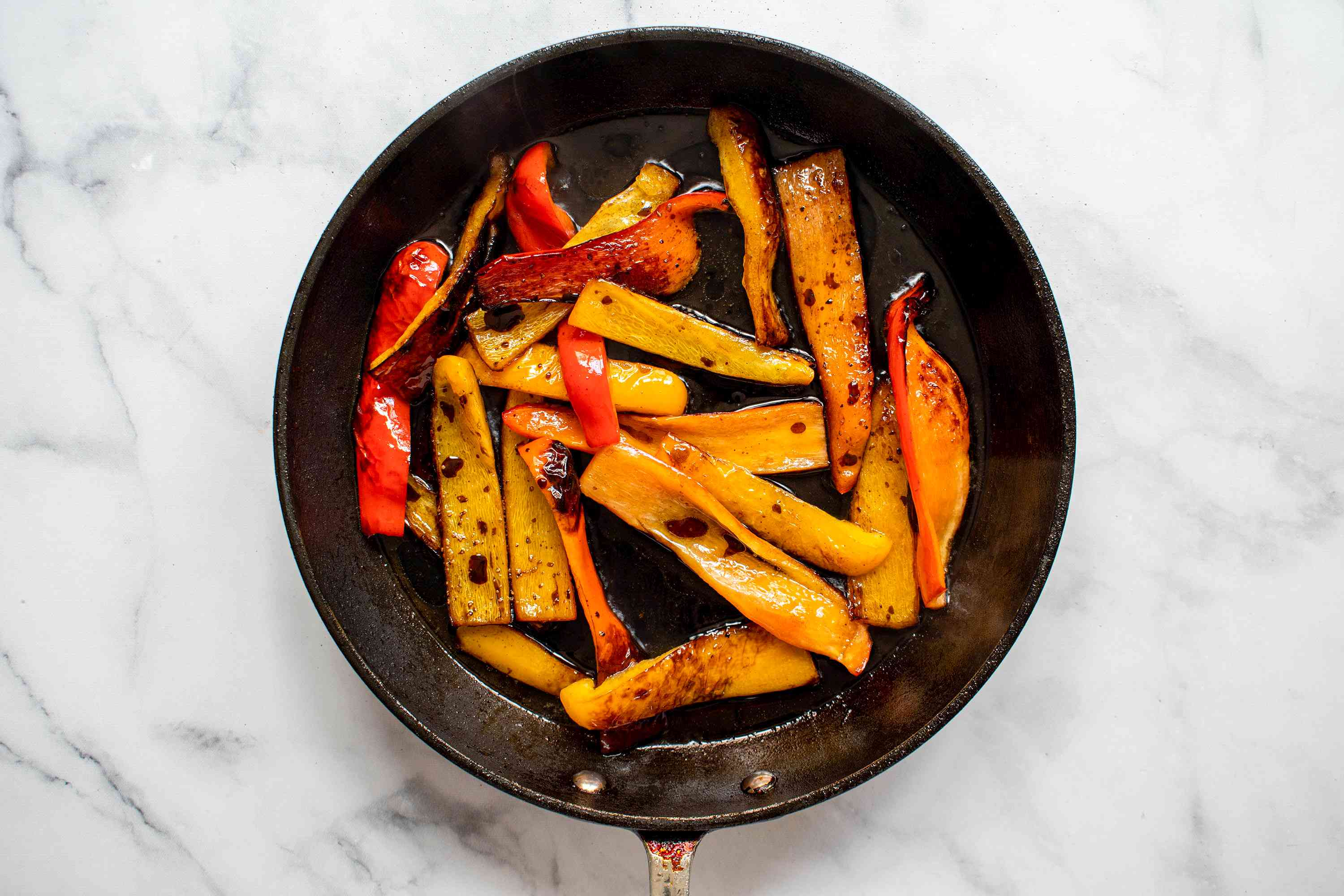 Stir the balsamic vinegar, pepper, and salt into the peppers